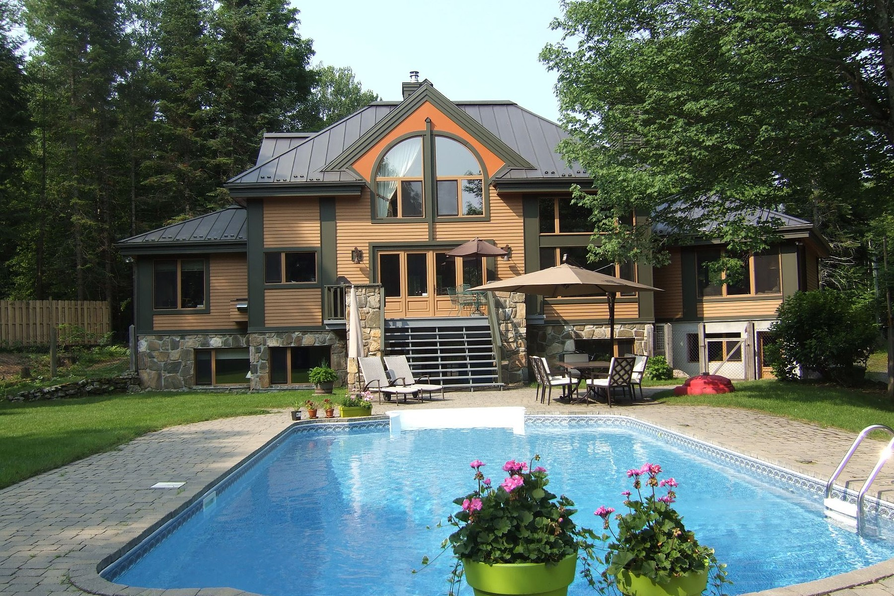Single Family Home for Sale at Mont-Tremblant, Laurentides 125 Ch. des Eaux-Vives Mont-Tremblant, Quebec, J8E1R8 Canada