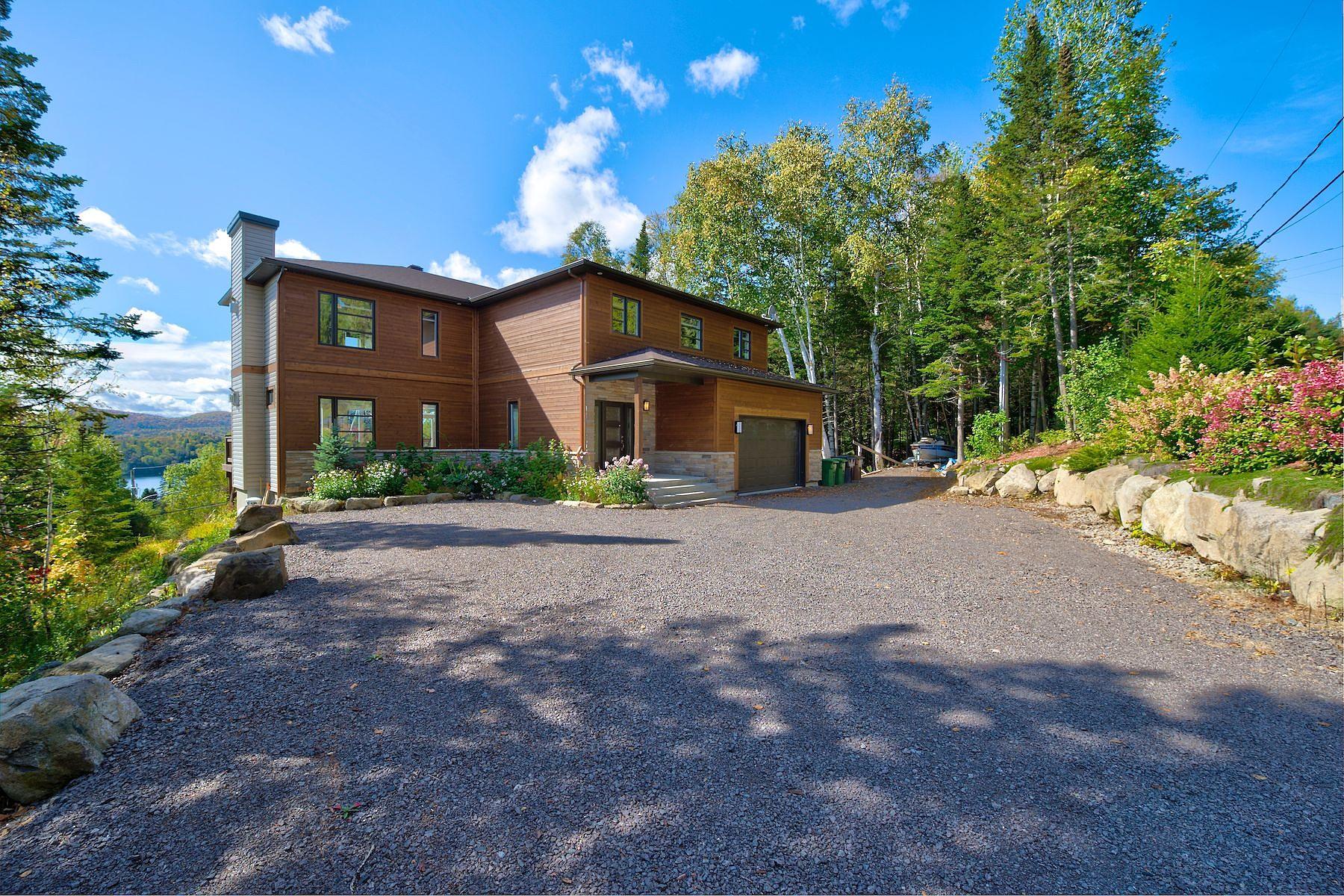Single Family Homes for Sale at Sainte-Agathe-des-Monts, Laurentides 7 Rue Félix-Leclerc Sainte-Agathe-Des-Monts, Quebec J8C2Z7 Canada
