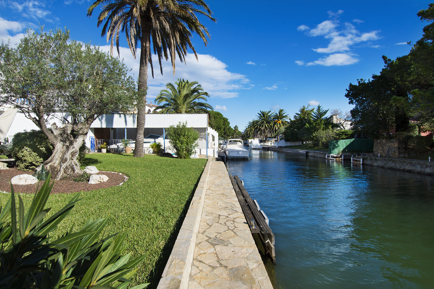 Single Family Home for Sale at Spacious property on the canal with boat garage and mooring Empuriabrava, Costa Brava, 17487 Spain