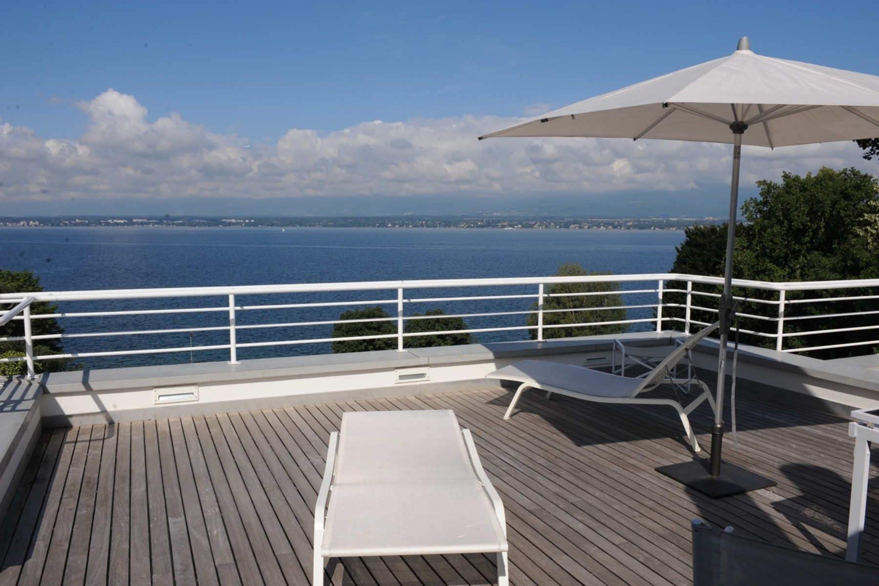 Property For Sale at Magnificent contemporary villa with unobstructed views of the lake
