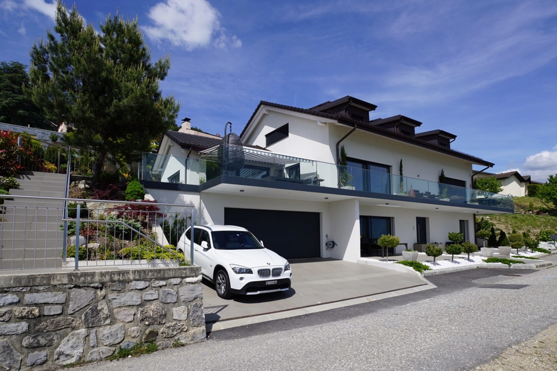 sales property at Contemporary property with 480 m² of living space and unobstructed lake views