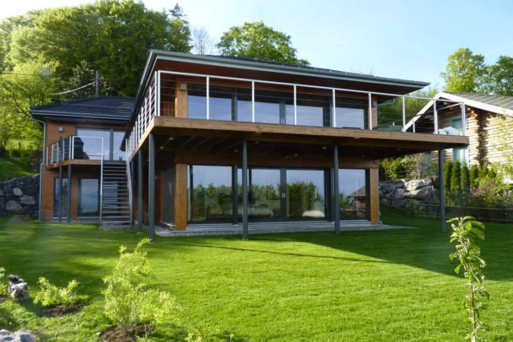 Property For Sale at Contemporary home with view of the lake and Alps