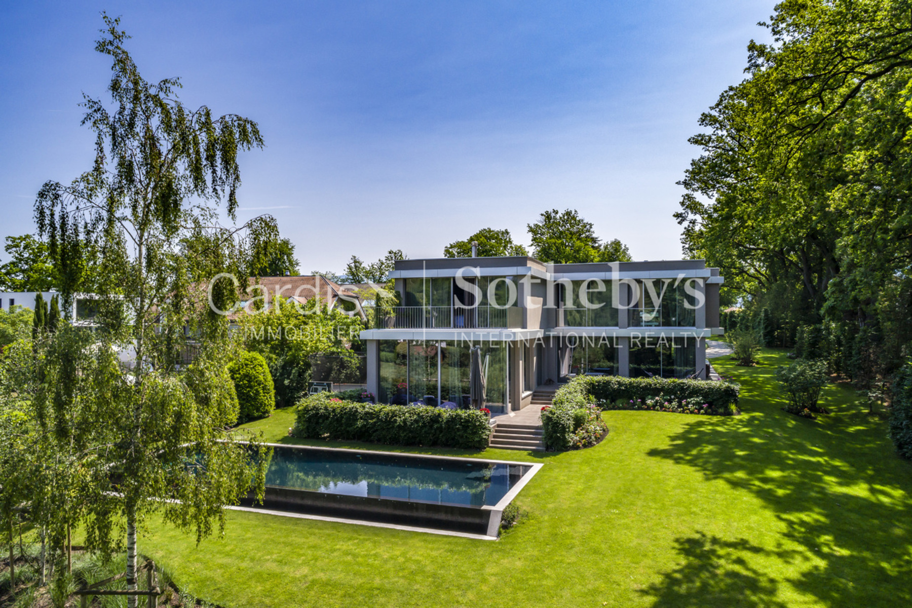 Single Family Homes 为 销售 在 Magnificent and contemporary villa with swimming pool Conches 孔什, 日内瓦 1231 瑞士