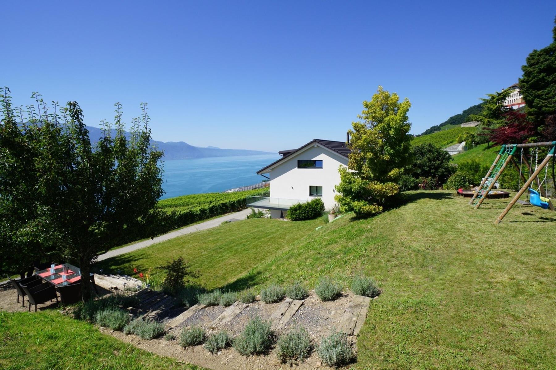 Maison unifamiliale pour l Vente à Contemporary property with 480 m² of living space and unobstructed lake views Chardonne, Chardonne, Vaud, 1803 Suisse