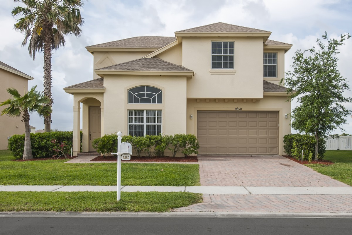 Single Family Home for Sale at Two Story Lakefront Home 9850 E. Verona Circle Vero Beach, Florida, 32966 United States