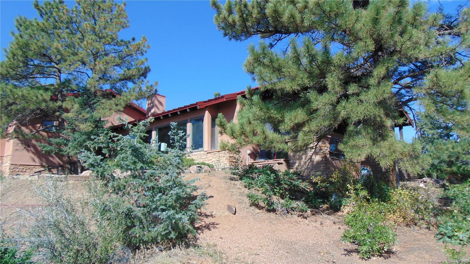 Single Family Home for Active at 52 acre wooded estate off of Jackson Creek Road, with great views of the valley. 7300 Jackson Creek Rd Sedalia, Colorado 80135 United States