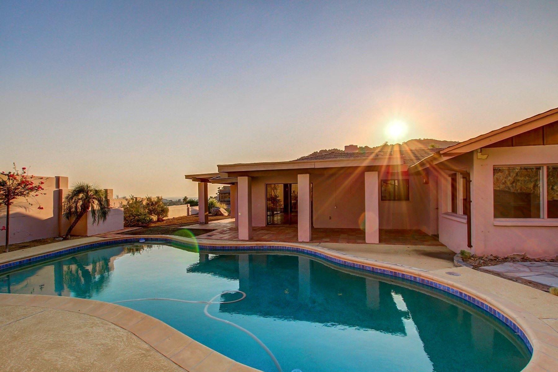 Nhà ở một gia đình vì Bán tại Lovely sold as is home on gated lot in Palm Canyon 6541 N 36th Street Phoenix, Arizona, 85018 Hoa Kỳ