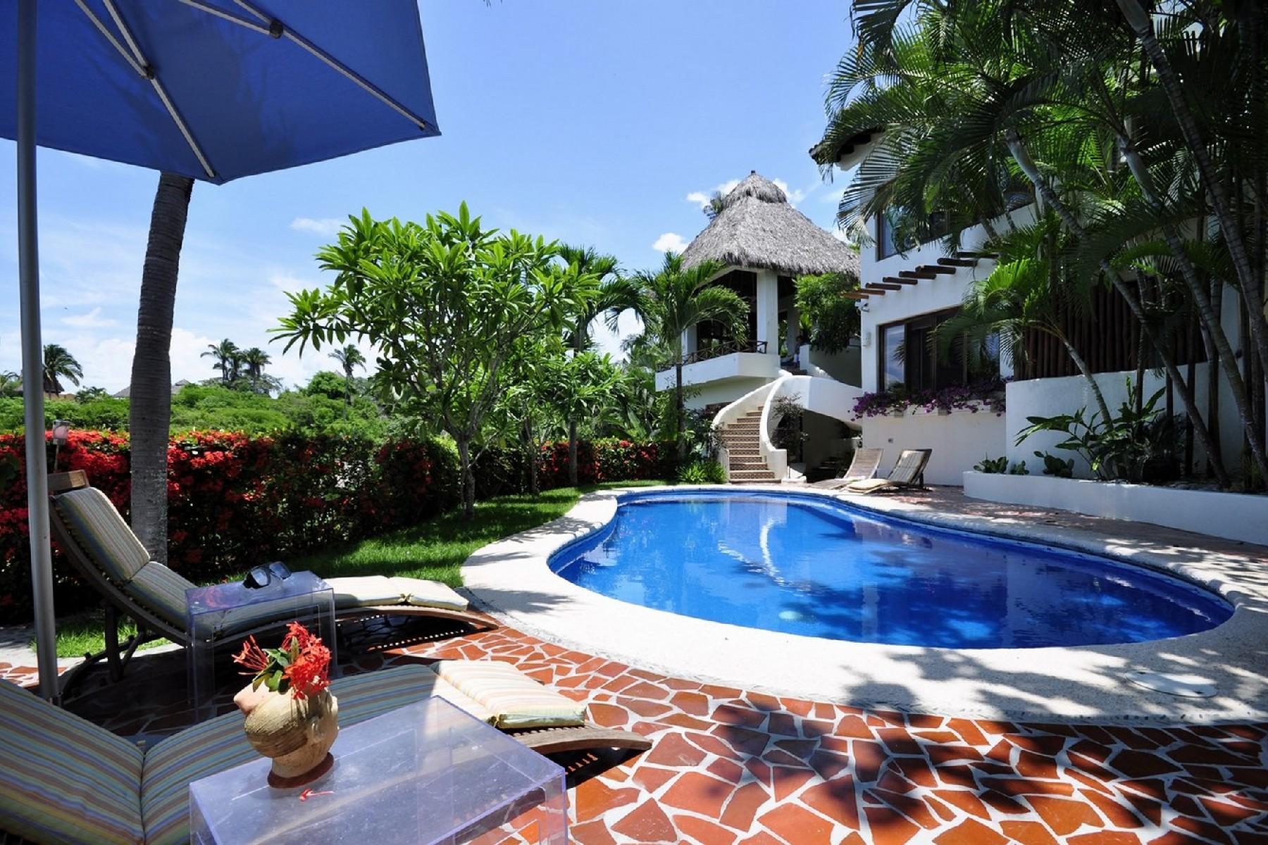 Casa Unifamiliar por un Venta en Casa Flores, Sayulita, Puerto Vallarta Calle Libertad 50 Sayulita, Nayarit 63734 México