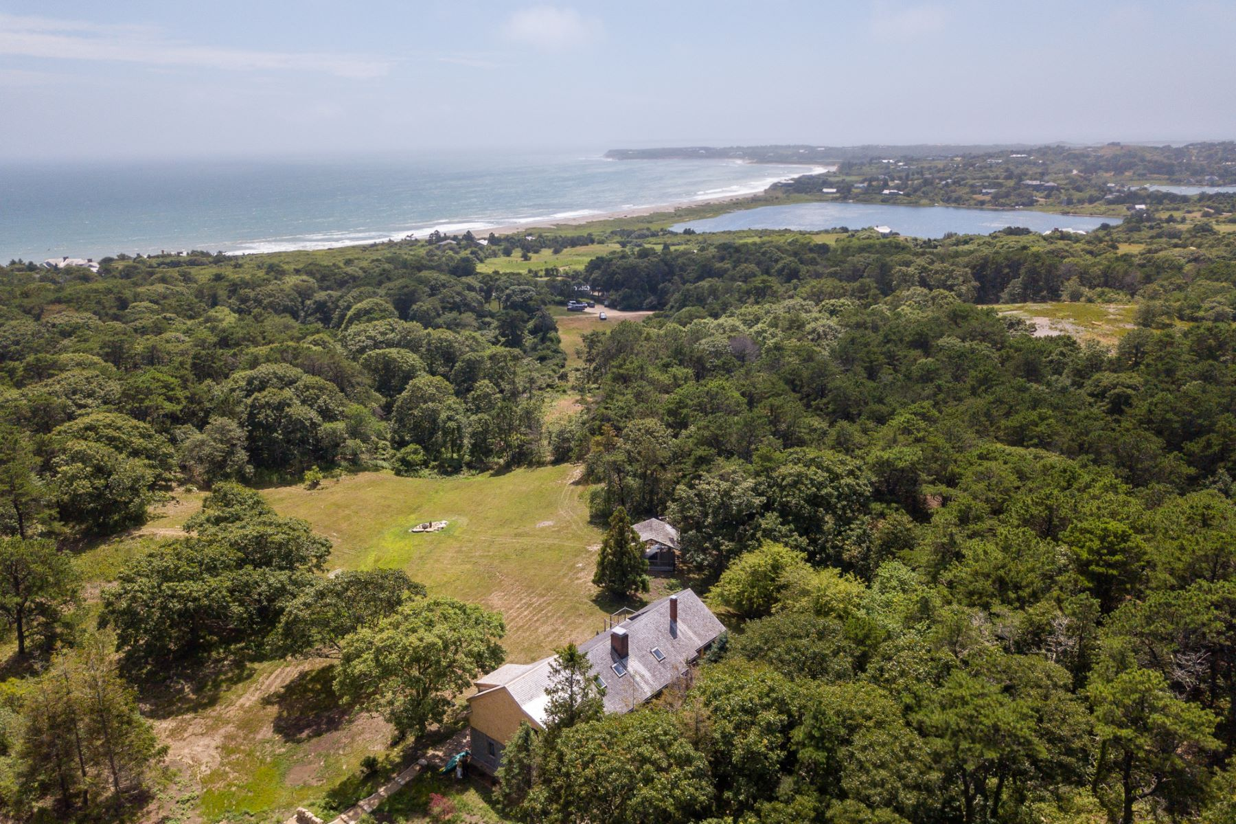Single Family Homes for Sale at Extraordinary home with distant ocean views 61 Stonewall Road Chilmark, Massachusetts 02535 United States