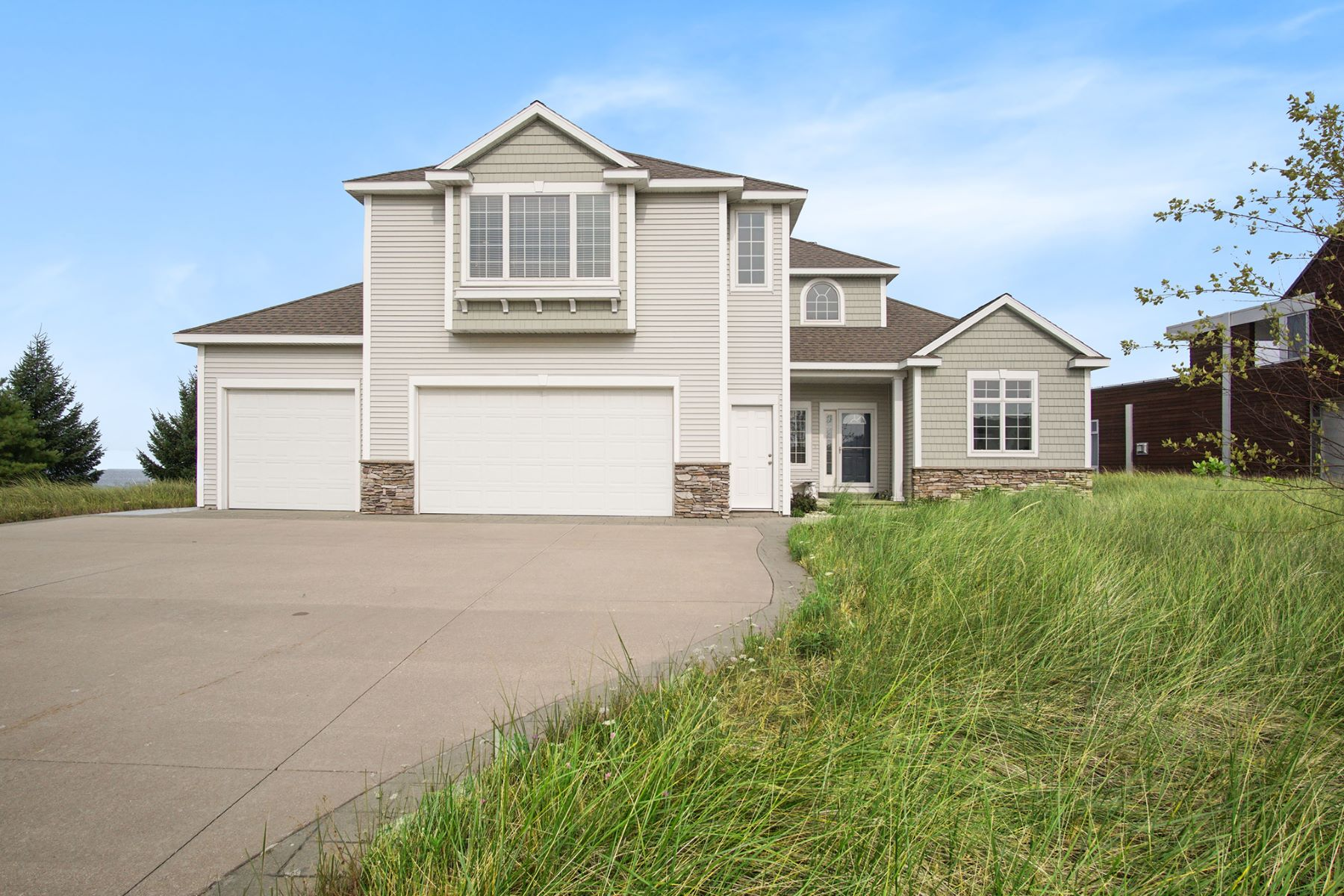 Single Family Homes for Sale at Lake Michigan Beachfront Home 324 Dunes Drive Manistee, Michigan 49660 United States