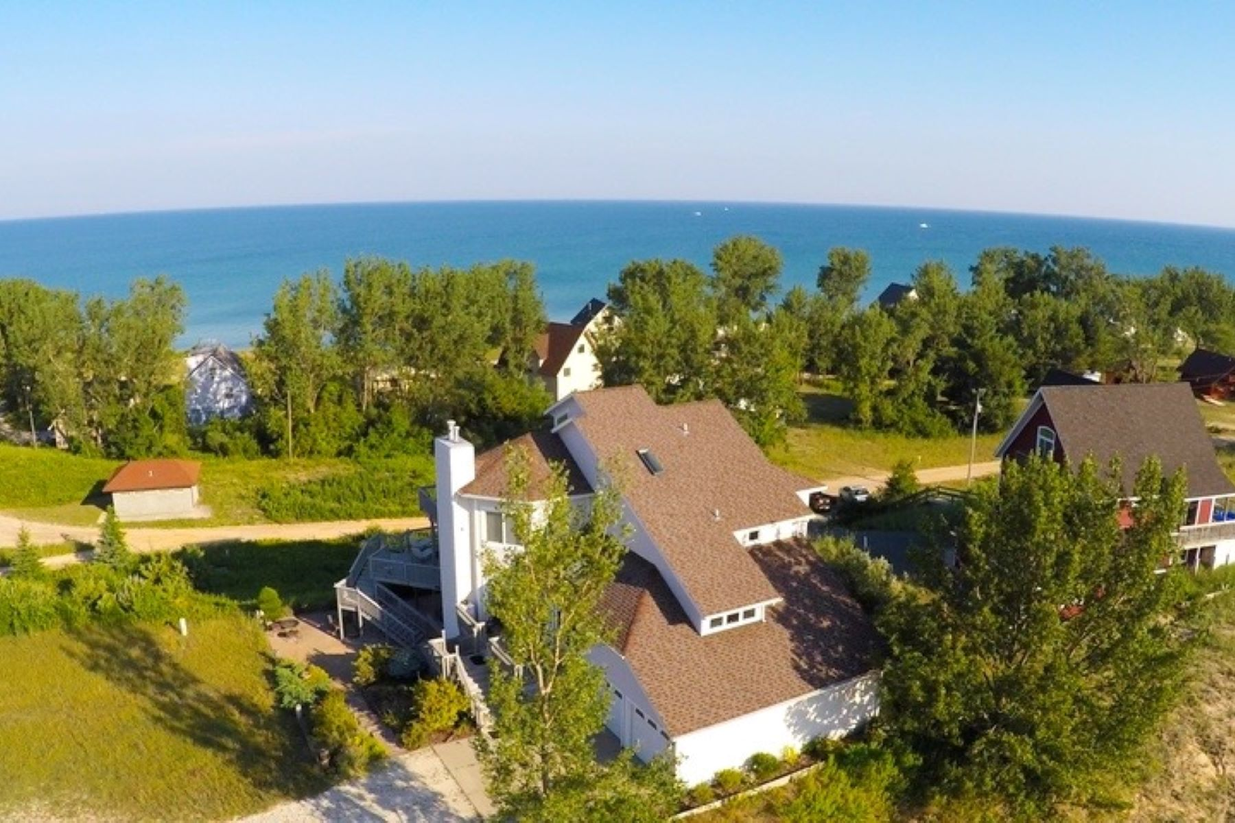 Single Family Homes for Sale at Captivating Beachfront Residence 2810 N Sahara Trail Mears, Michigan 49436 United States