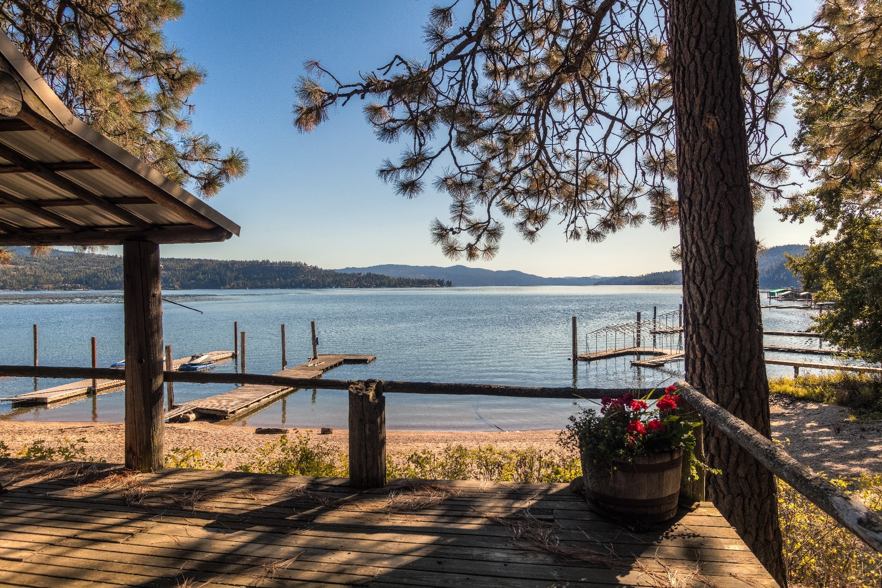 Single Family Homes for Sale at Waterfront Swede Bay Cabin with Acreage 1460 W Swede Bay Rd Coeur D Alene, Idaho 83814 United States