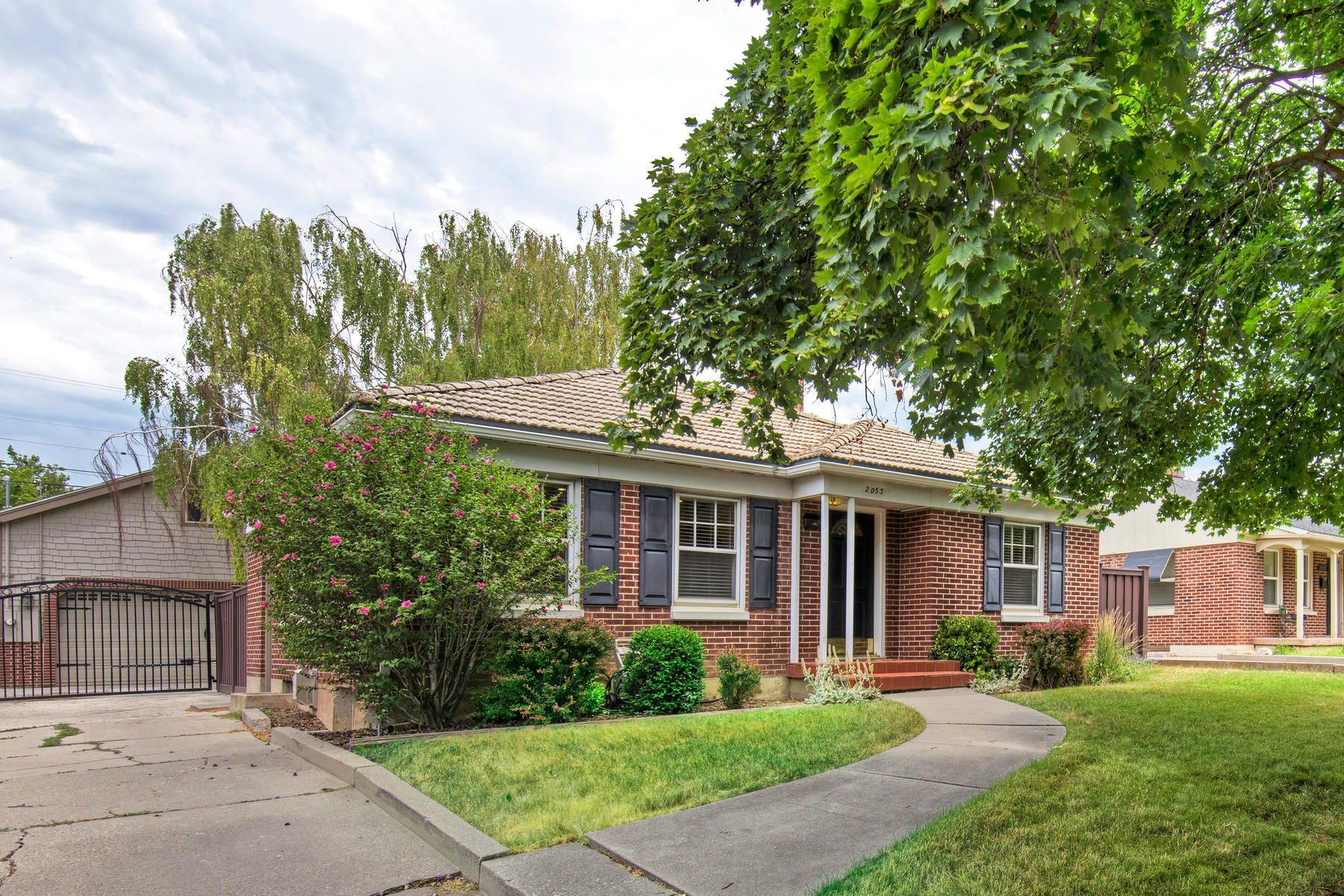 Single Family Home for Sale at Quintessential Red Brick Bungalow 2053 E Hollywood Ave Salt Lake City, Utah, 84108 United States