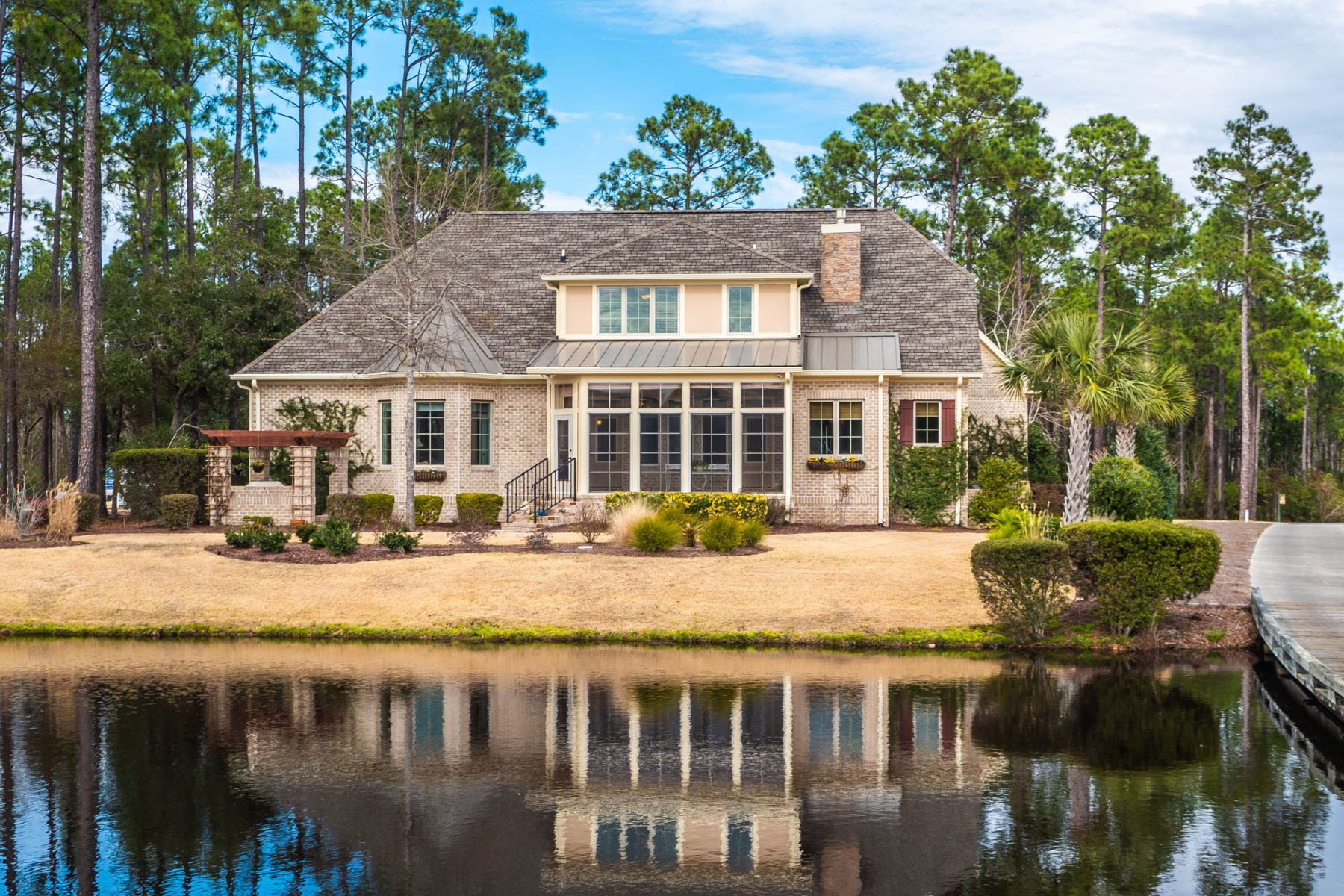 Single Family Home for Active at Purposefully designed home in prestigious community 3196 Moss Hammock Wynd Southport, North Carolina 28461 United States