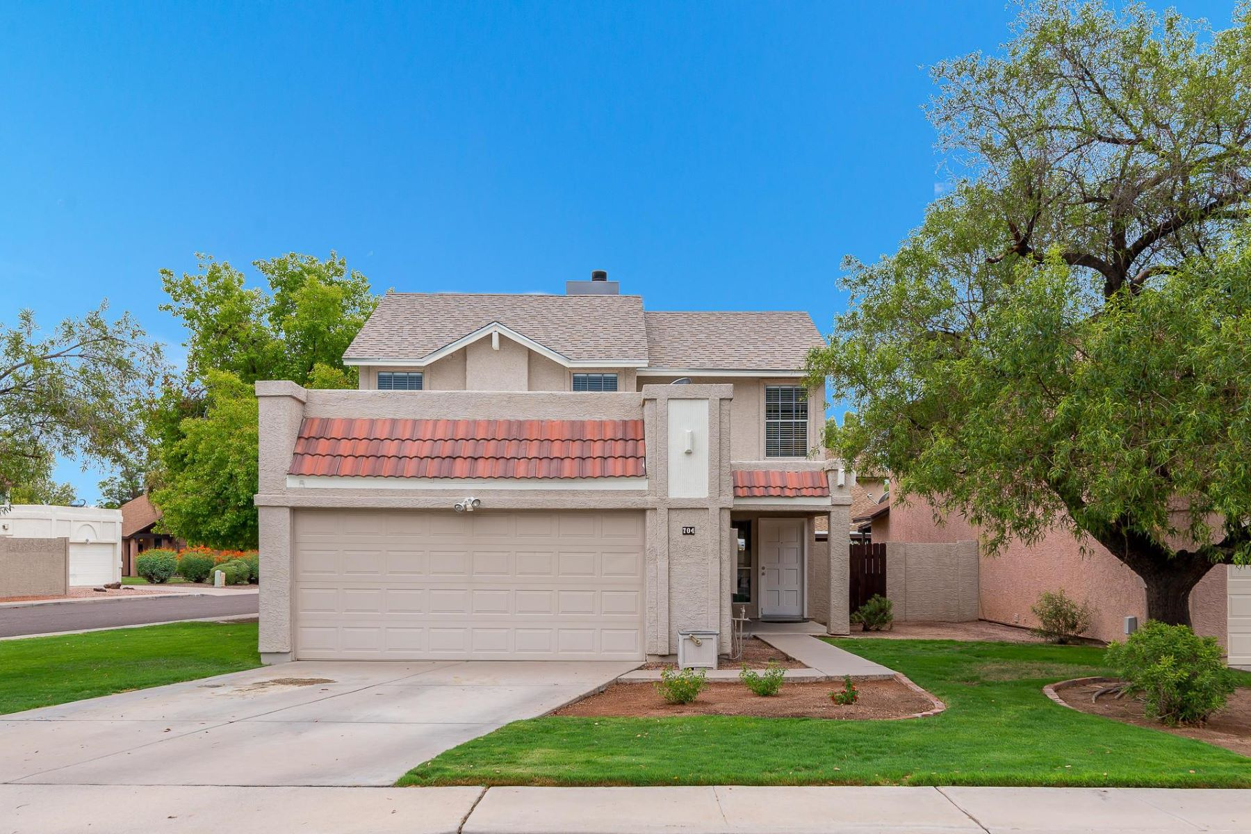 Single Family Home for Sale at Lovely home situated in highly sought-after Copperfield Estates 704 N Country Club Way Chandler, Arizona 85226 United States