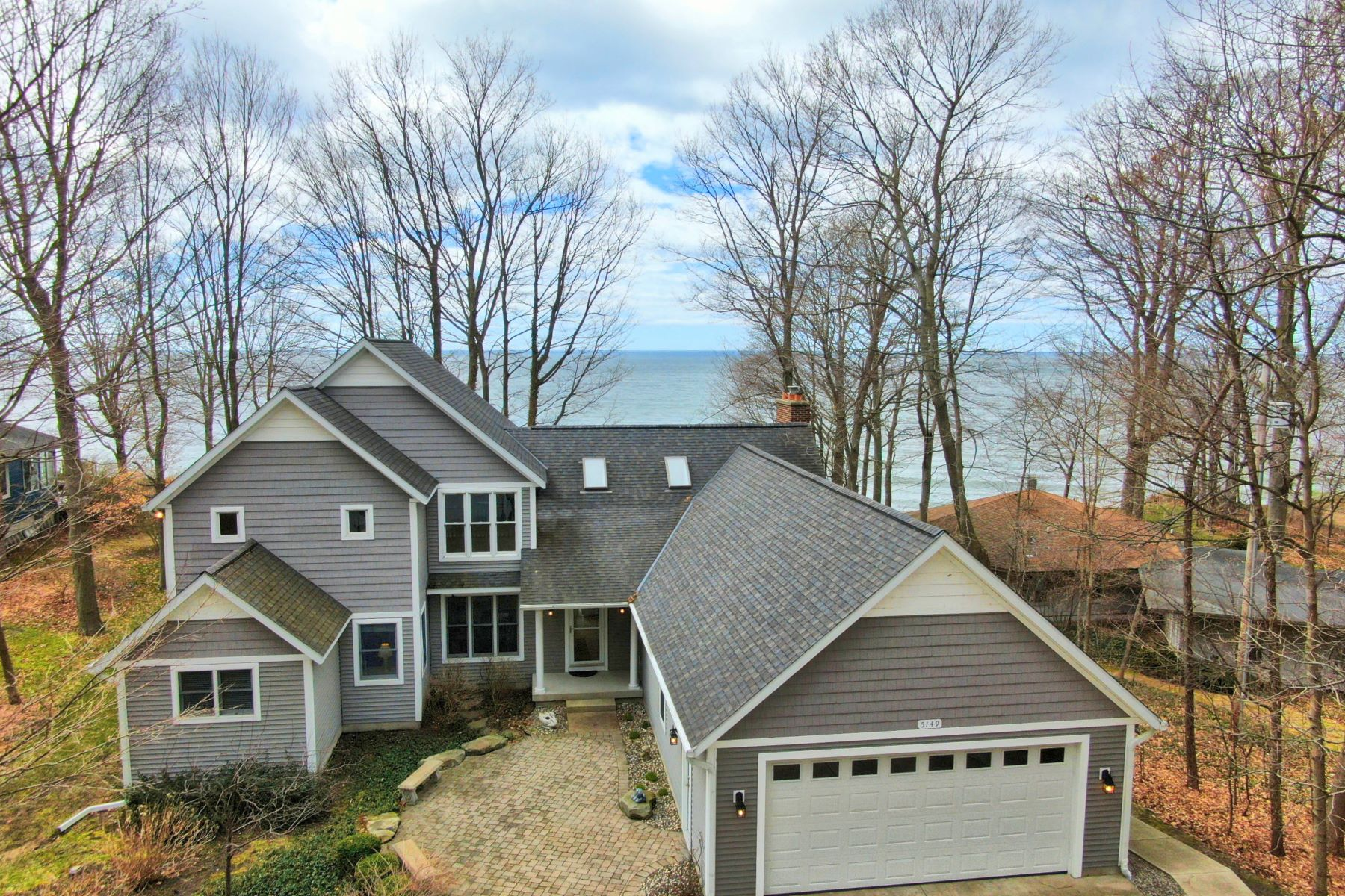 Single Family Homes for Sale at Exquisite Waterfront Estate with Coveted Frontage 5149 Rosabelle Beach Avenue Holland, Michigan 49424 United States