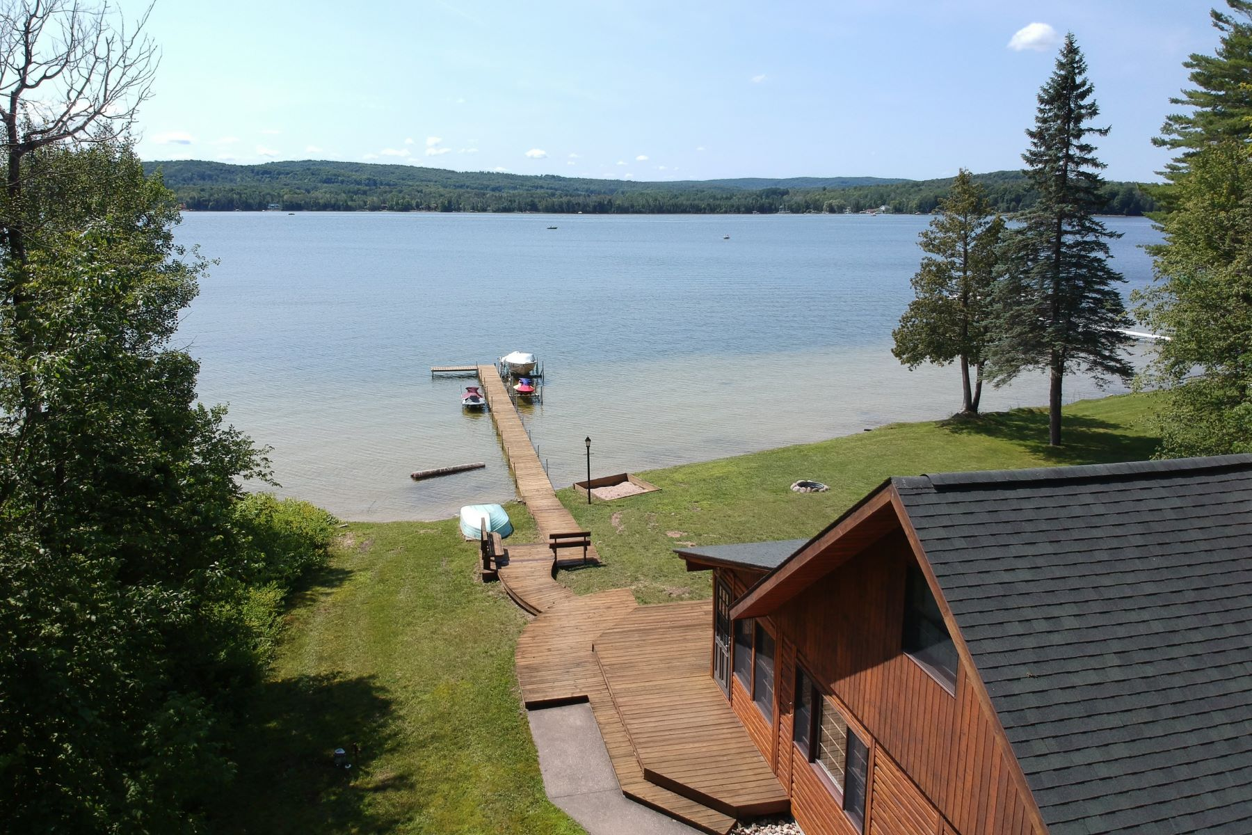 Single Family Homes for Active at Town and Country waterfront log home on Pickerel Lake 10696 McCarthy Drive Alanson, Michigan 49706 United States