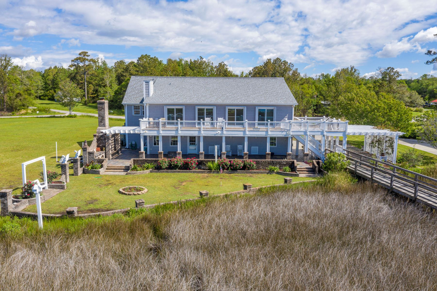 Single Family Homes for Sale at Entertainer's and Gardener's Dream Home 205 Topsail Watch Drive Hampstead, North Carolina 28443 United States