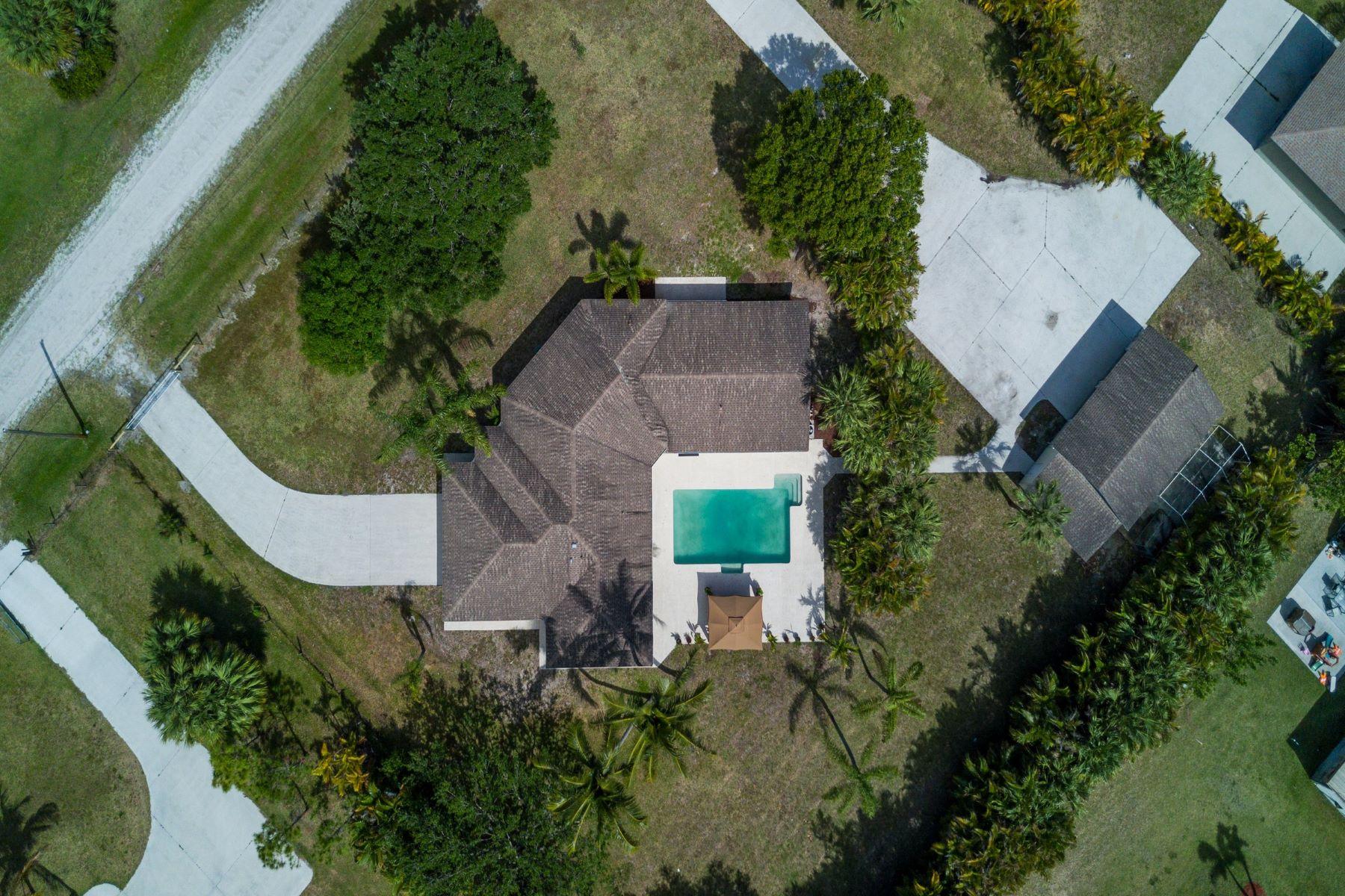 独户住宅 为 销售 在 16106 73rd Terrace N Palm Beach Country Estates, 棕榈滩花园, 佛罗里达州, 33418 美国