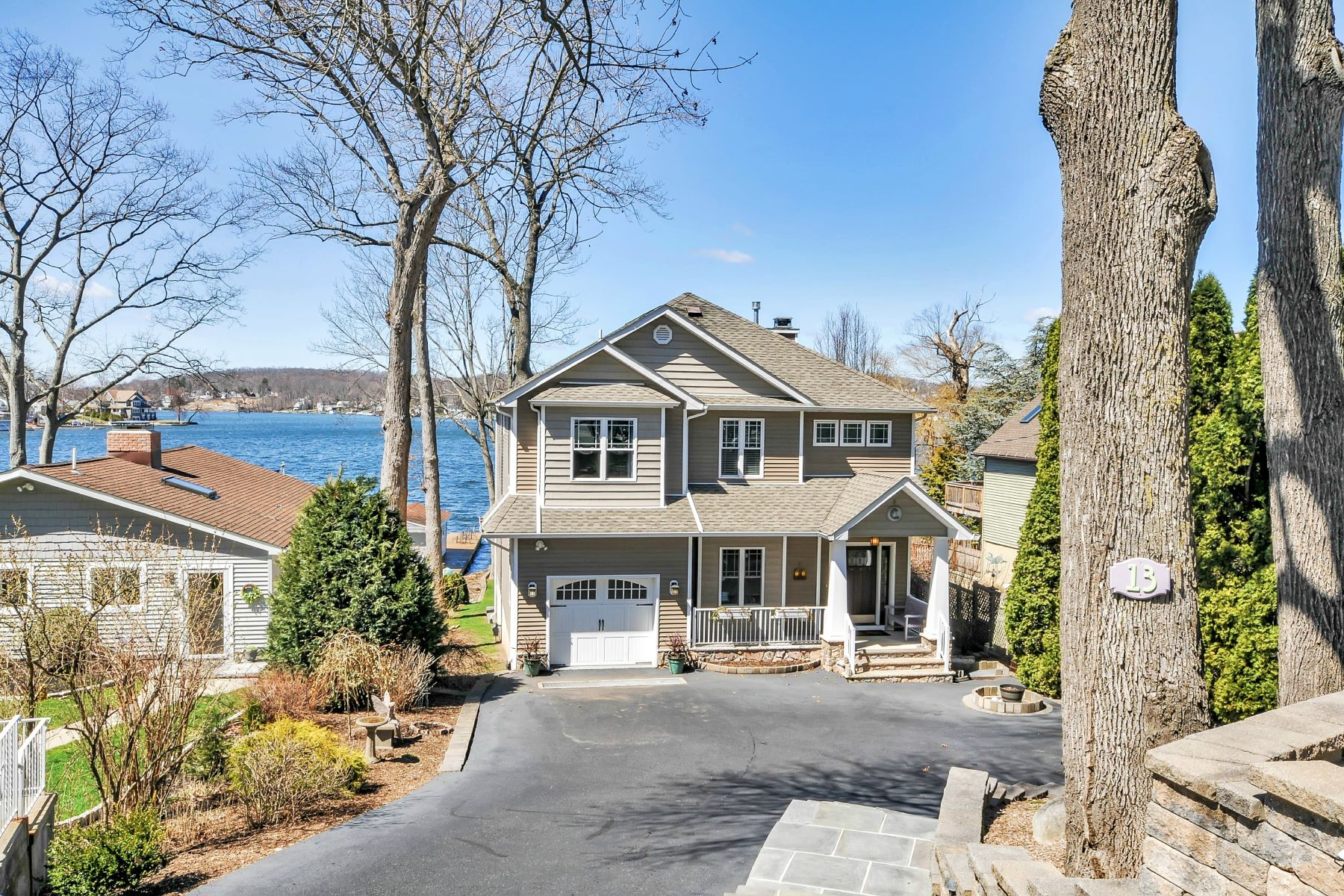 Single Family Home for Sale at Amazing lakefront views and sunsets all year long. 13 Bertrand Island Road Mount Arlington, New Jersey 07856 United States