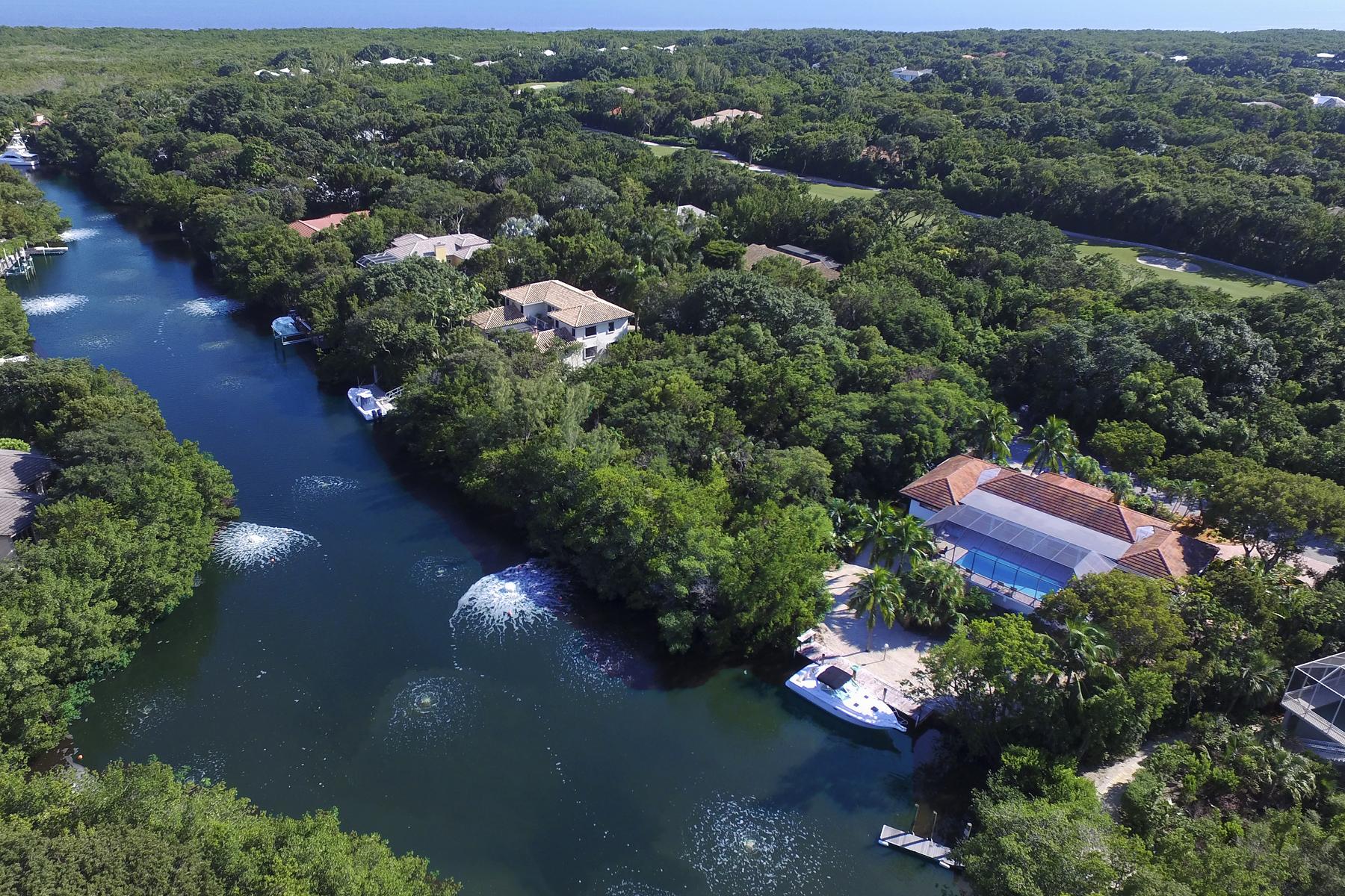 Tek Ailelik Ev için Satış at Canalfront Home at Ocean Reef 12 South Bridge Lane Ocean Reef Community, Key Largo, Florida, 33037 Amerika Birleşik Devletleri