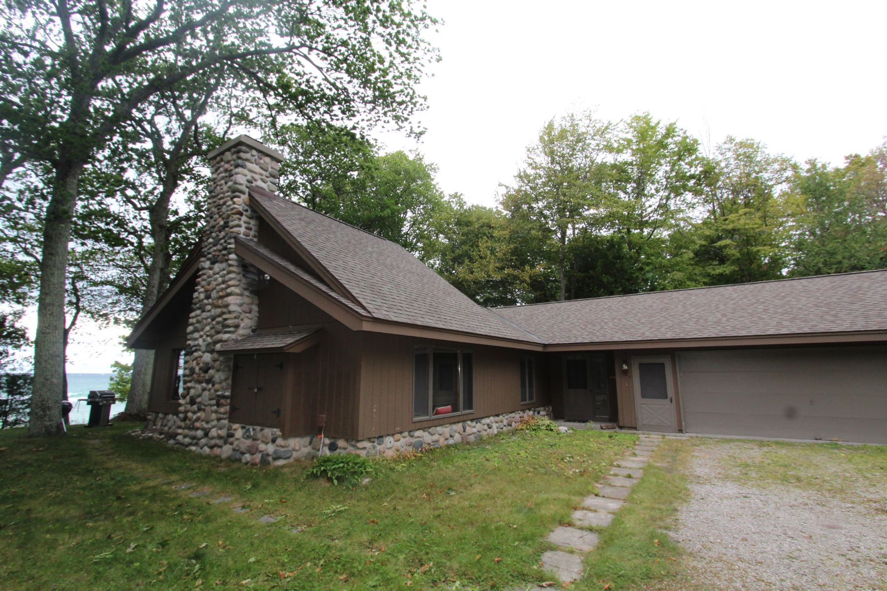 Single Family Homes for Active at 1953 Bliss Cottage with Lake Michigan waterfront 784 S. Lamkin Road Harbor Springs, Michigan 49740 United States