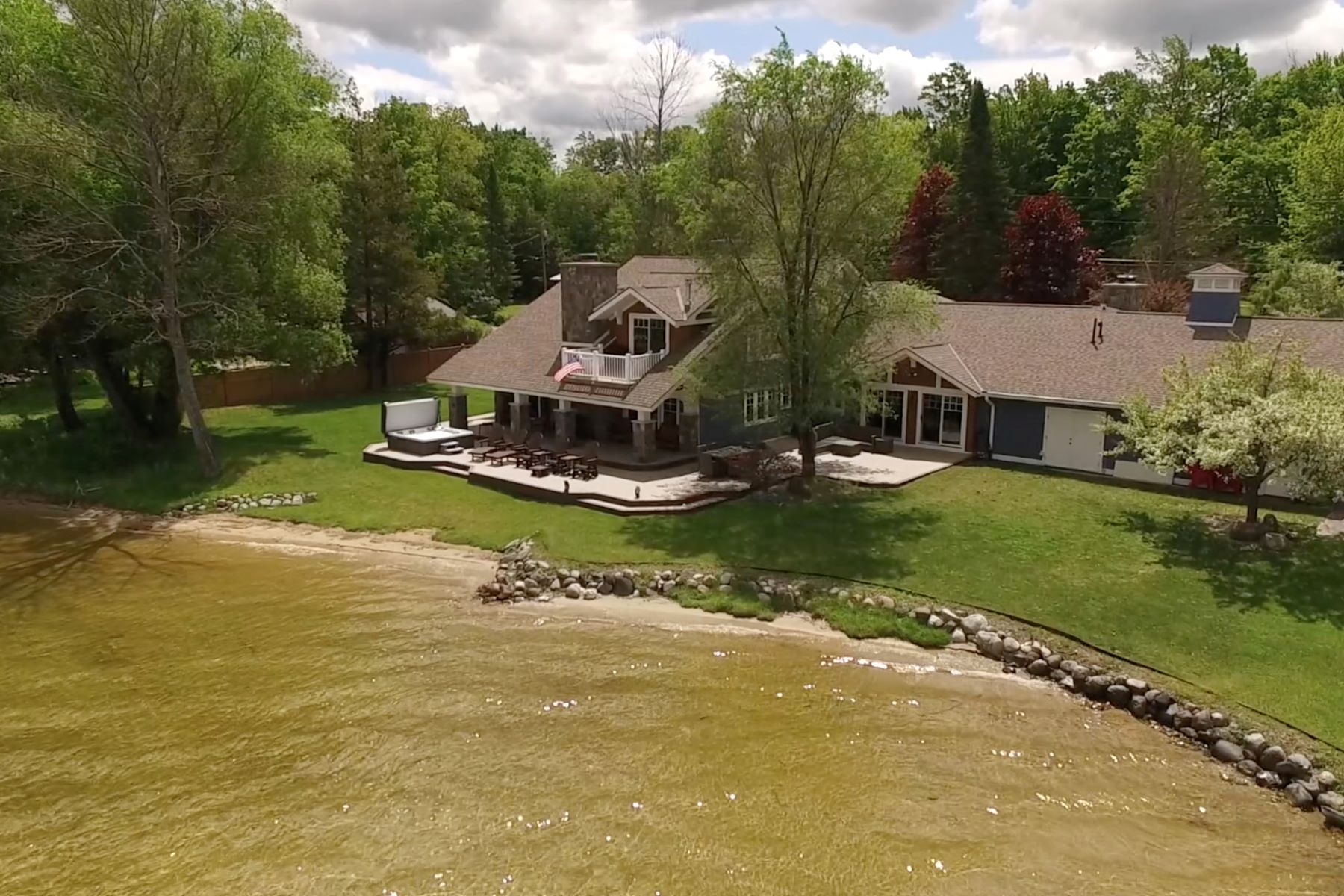 Single Family Homes for Sale at Waterfront Home on Pickerel Lake 9633 Trails End Road Petoskey, Michigan 49770 United States