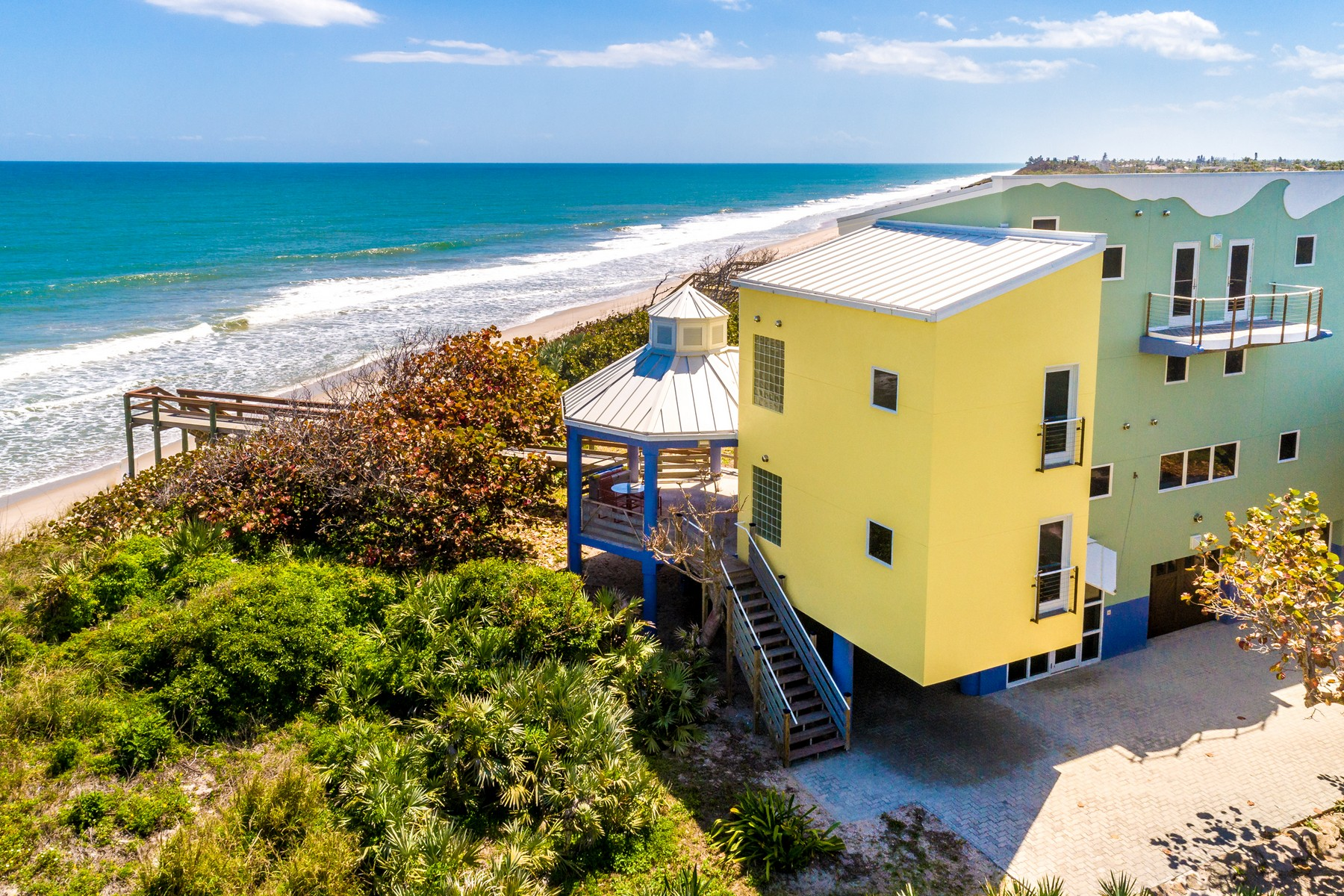 Single Family Homes for Sale at Spectacular Oceanfront Home Bordering Nature Preserve. 4515 Highway A1A Melbourne Beach, Florida 32951 United States