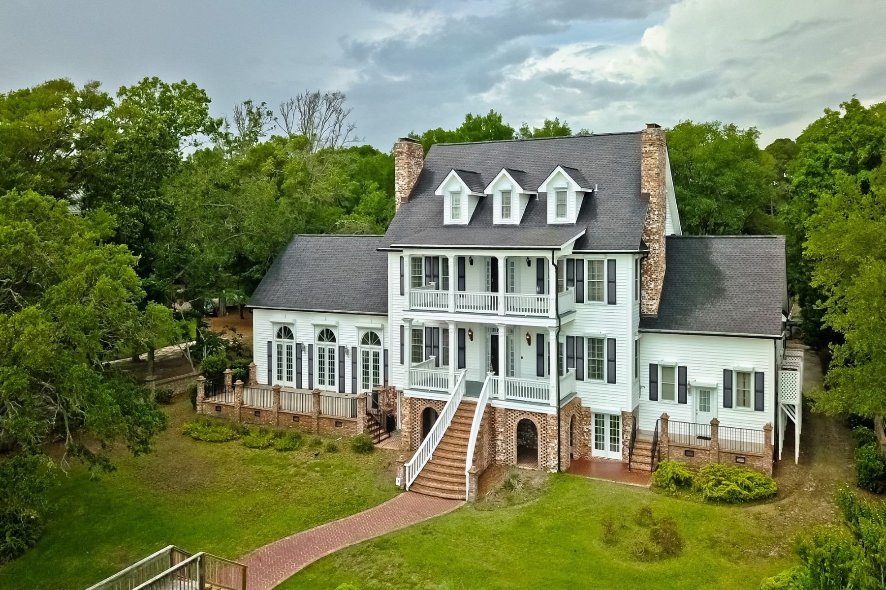 Single Family Homes for Active at Private Gated Waterfront Grand Estate 815 Shoreline Drive W Sunset Beach, North Carolina 28468 United States