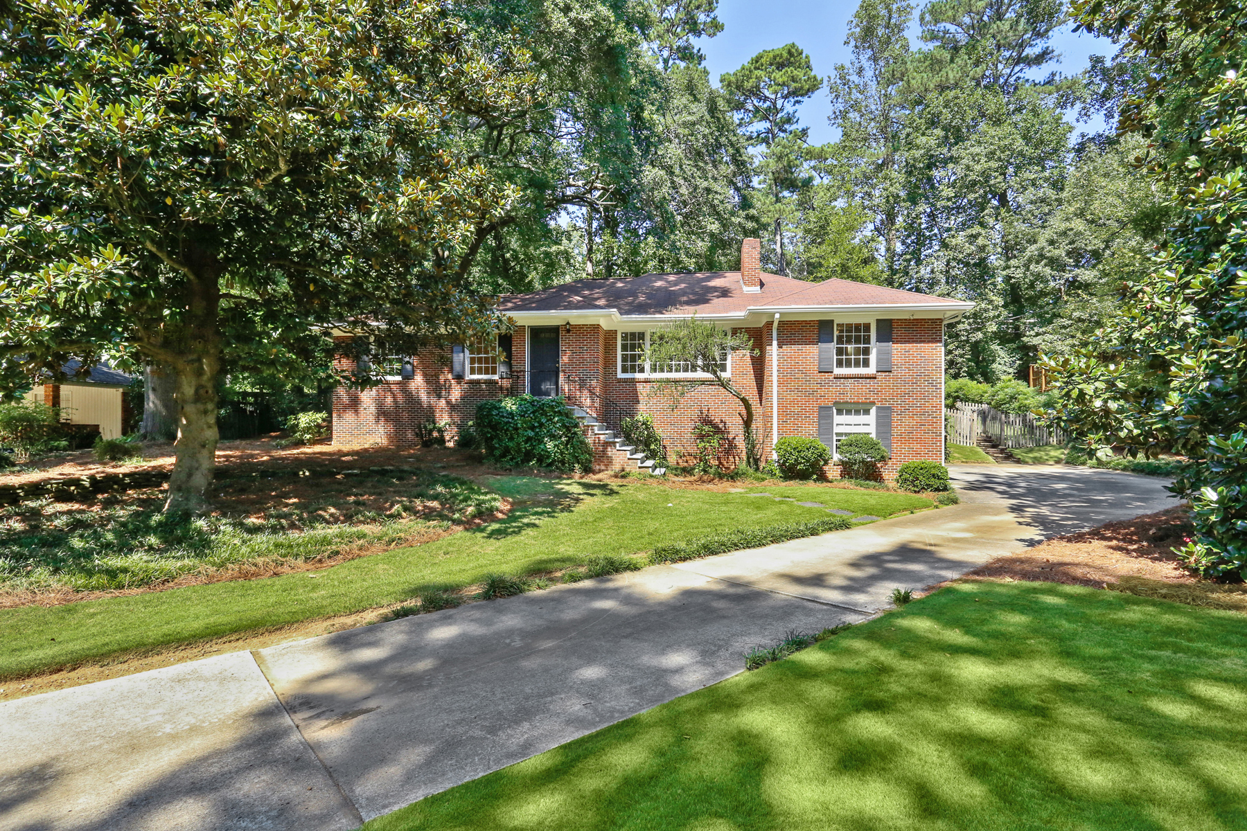 Single Family Home for Sale at Charming Brick Ranch On A Large Lot With Incredible Backyard 388 Lakemoore Drive NE Atlanta, Georgia 30342 United States