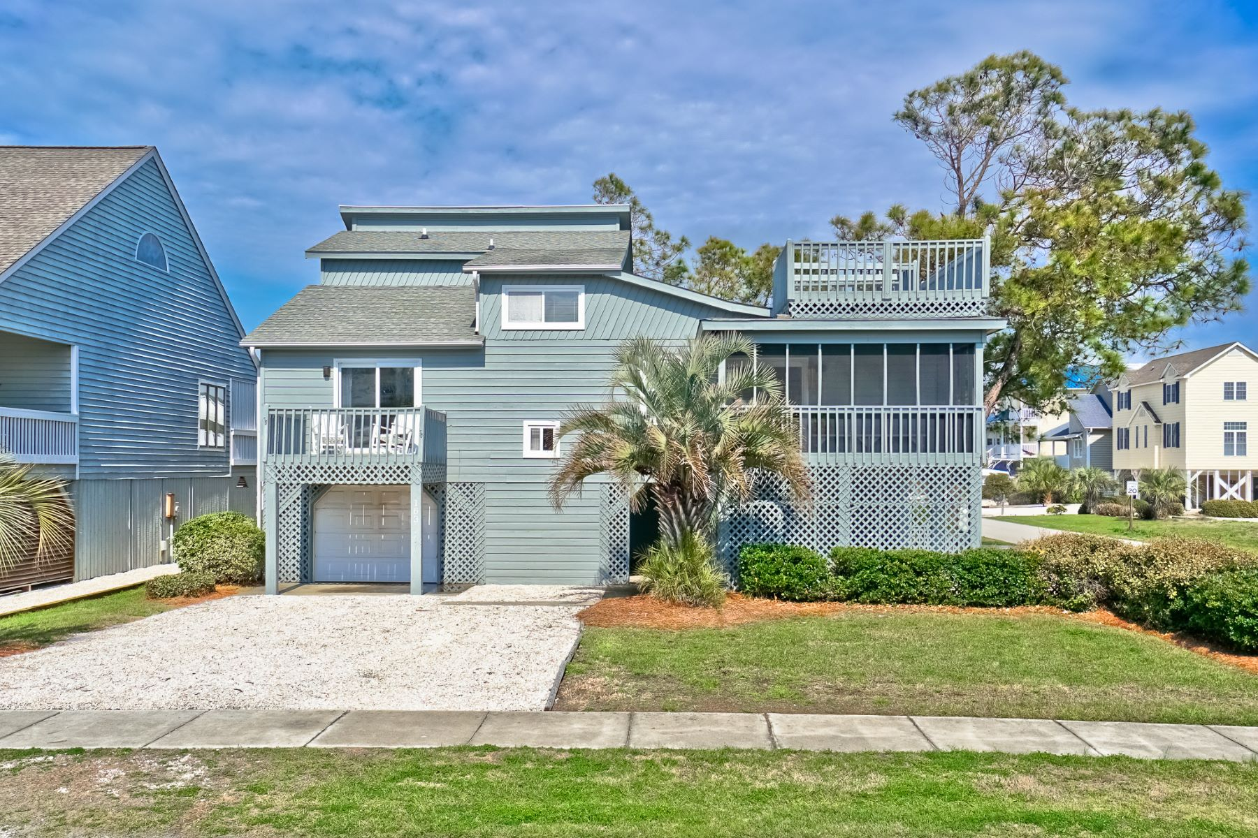Single Family Home for Sale at Spacious Canal Home Located on Oversized Corner Lot 163 E Second Street, Ocean Isle Beach, North Carolina, 28469 United States