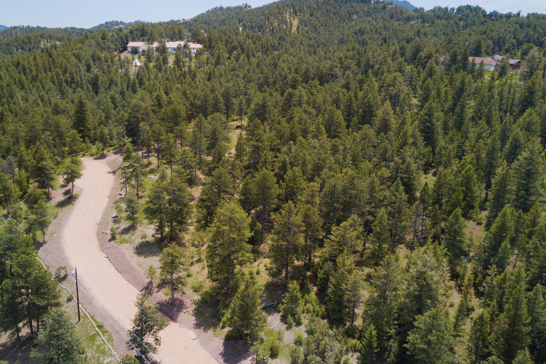 Land for Active at Spectacular Southern Exposed Lot with Views of Surrounding Mountain Vistas 3367 Bronco Lane Evergreen, Colorado 80439 United States