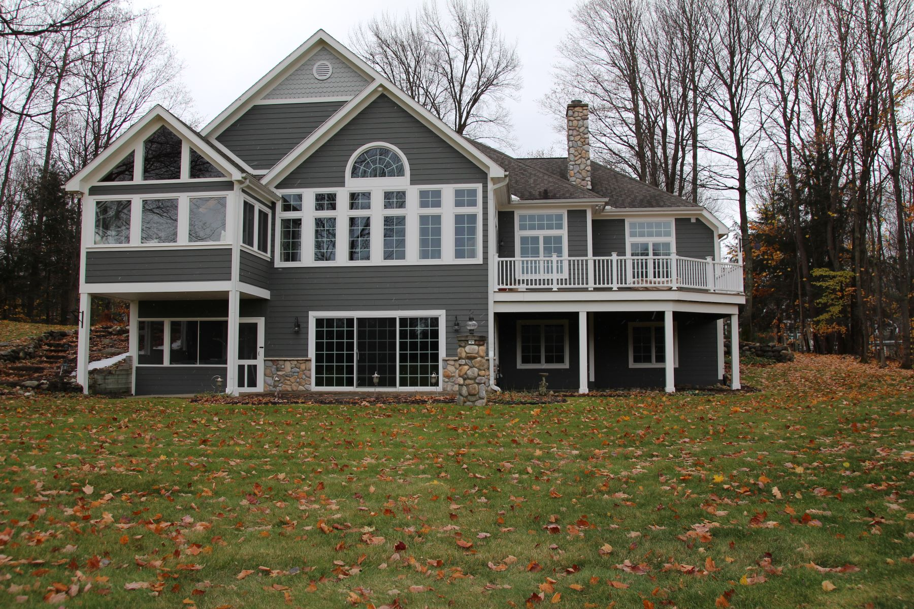 Single Family Homes for Active at Boyne Highlands golf course view home. 690 Woodhill Road Harbor Springs, Michigan 49740 United States