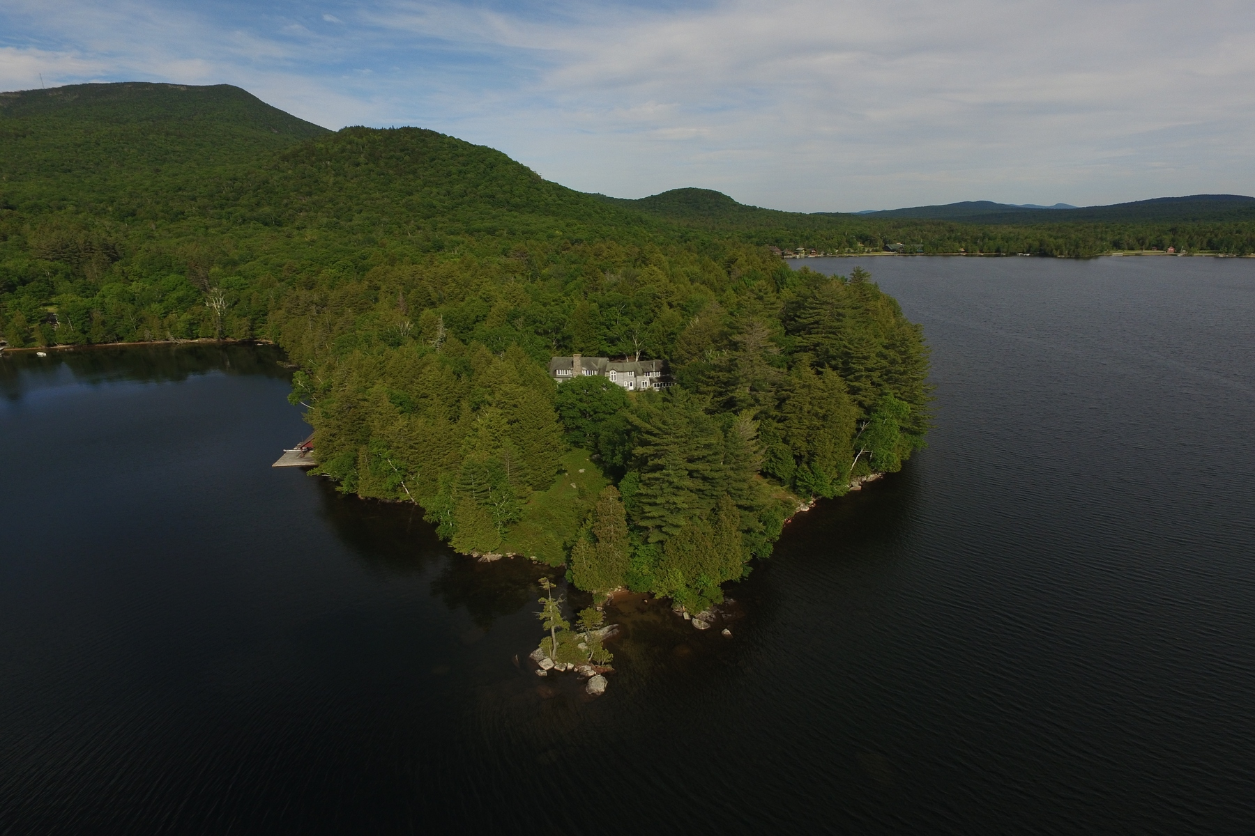 Single Family Homes for Sale at Great Camp Era Peninsula 155 Crane Point Lane Blue Mountain Lake, New York 12812 United States