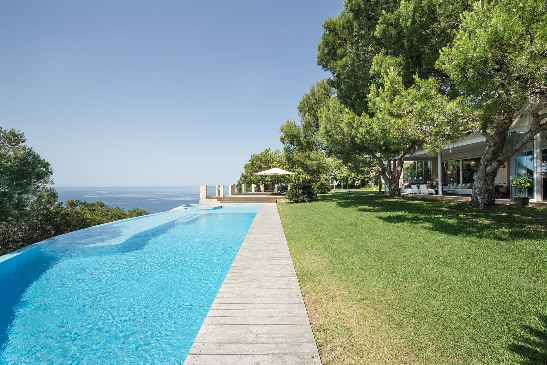 Single Family Home for Sale at Modern villa on the coast of Puig de Ros Other Balearic Islands, Balearic Islands, Spain
