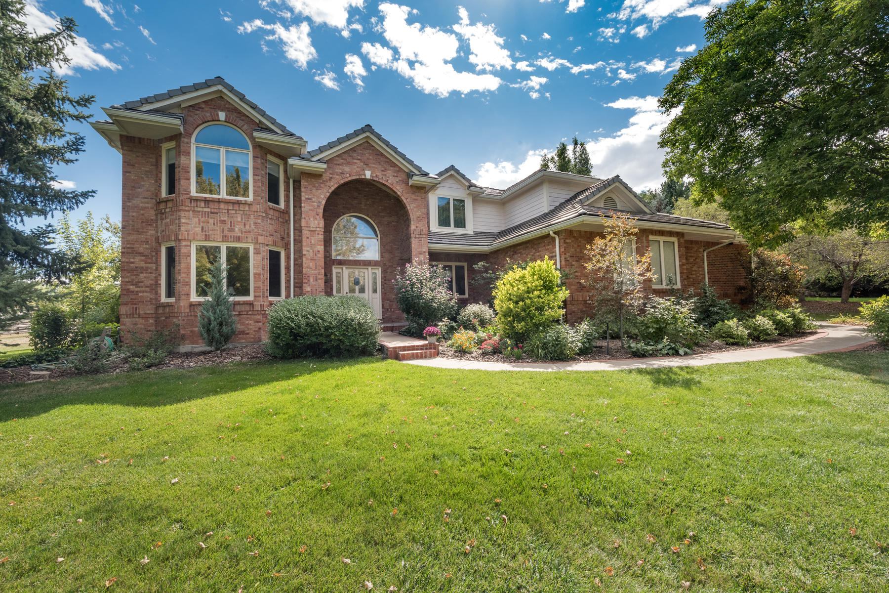 Single Family Homes for Sale at Custom 2-story home nestled on a serene park-like lot in Greenwood Village 5430 S Cottonwood Ct Greenwood Village, Colorado 80121 United States