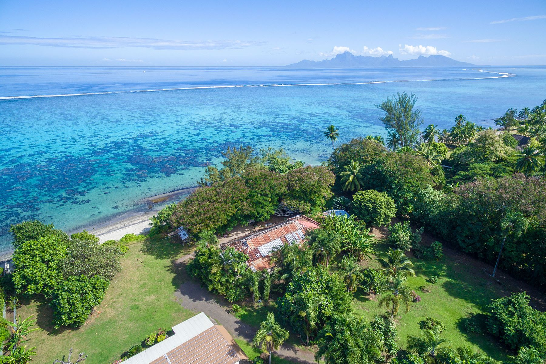 Single Family Home for Sale at Facing Moorea on a white sand beach Tahiti, French Polynesia