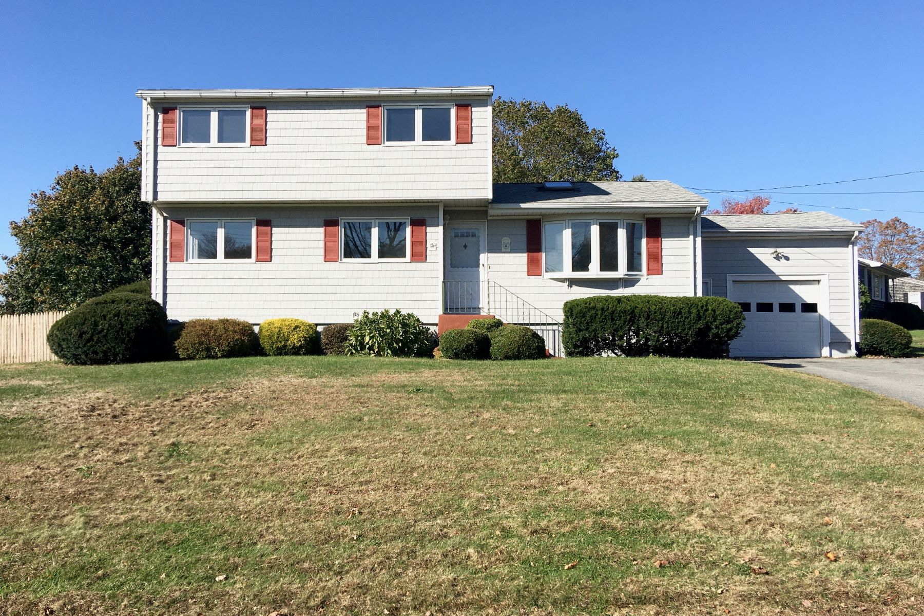 Single Family Homes for Sale at Bright and Sunny 31 Redwood Road Portsmouth, Rhode Island 02871 United States