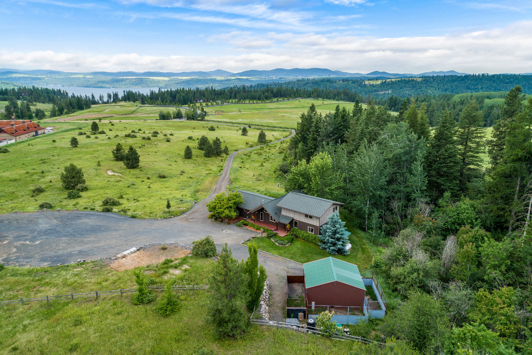 Single Family Homes for Sale at Rockford Bay Beauty w/Lake Views 25027 S Loffs Bay Rd Coeur D Alene, Idaho 83814 United States