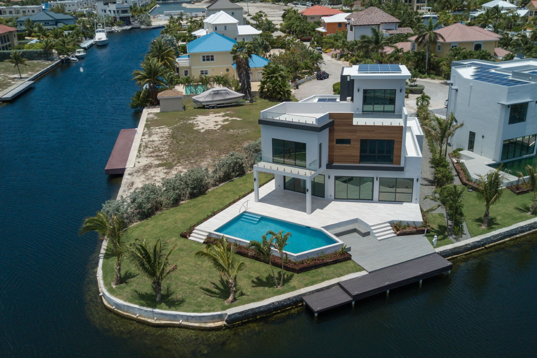 Single Family Home for Sale at HQ, Hoya Quay Contemporary Crystal Harbour Home Crystal Harbour, Cayman Islands