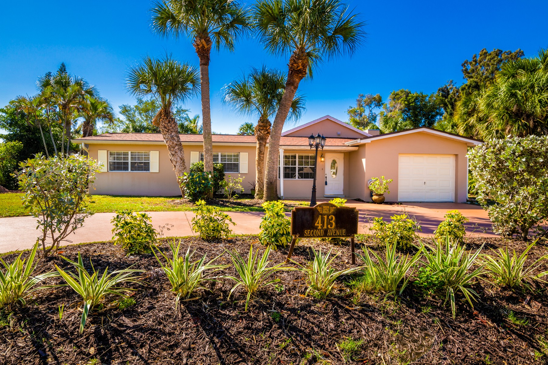 Single Family Home for Sale at Spacious Pool Home Ideal for Entertaining. 413 Second Avenue Melbourne Beach, Florida 32951 United States