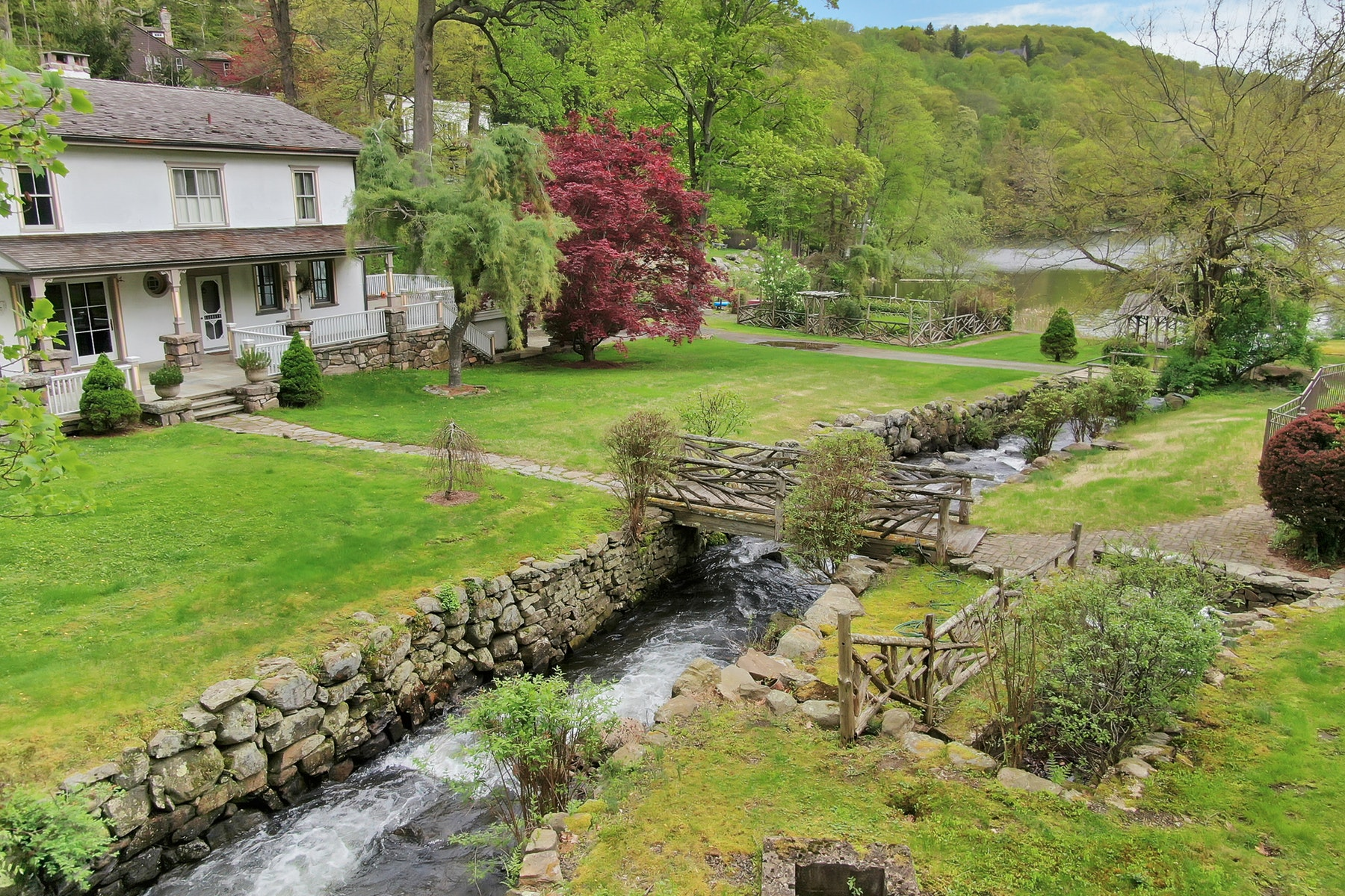 Single Family Homes for Sale at The Old Fish Hatchery - Lakefront 23 West Lake Road Tuxedo Park, New York 10987 United States
