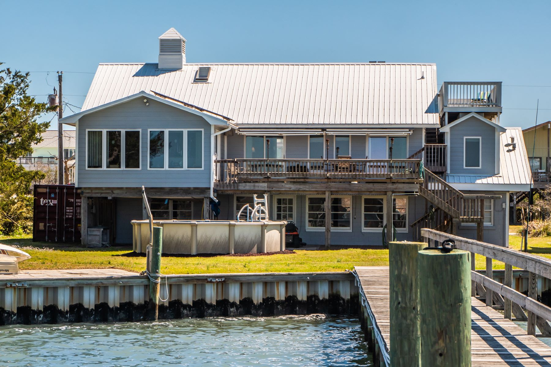 Single Family Homes for Sale at Soundfront Home with Deep Water Pier 212 Bridgers Ave Topsail Beach, North Carolina 28445 United States