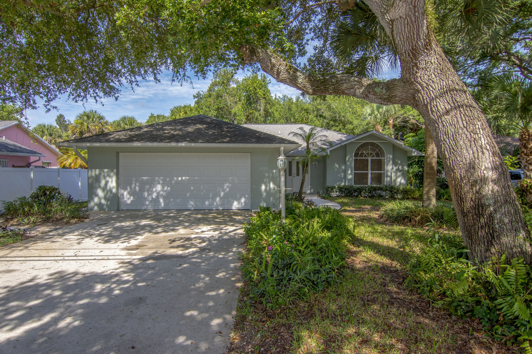 Single Family Homes for Sale at Three Bedroom Home on a Canopied Lot 9335 Seagrape Drive Vero Beach, Florida 32963 United States