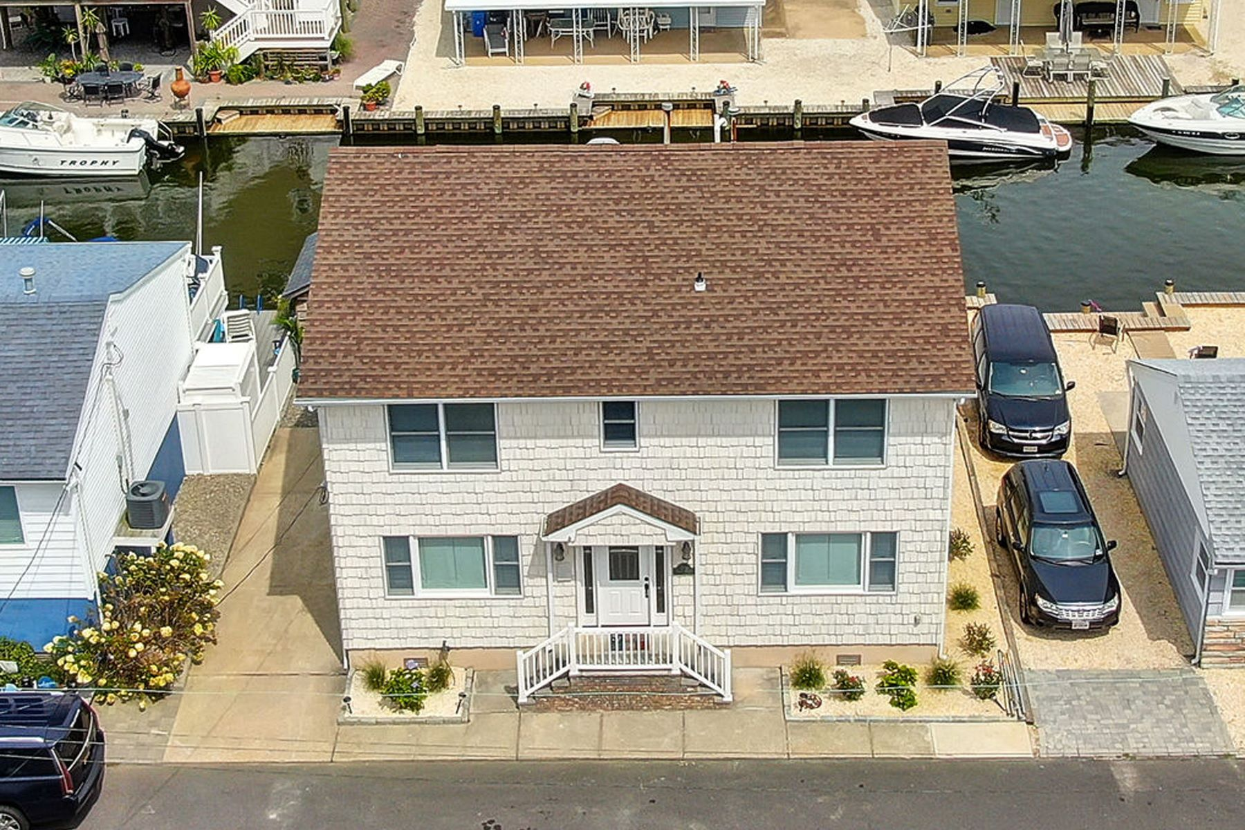 Single Family Homes للـ Sale في Custom Lagoon Waterfront Home 218 Joseph Street, Lavallette, New Jersey 08735 United States
