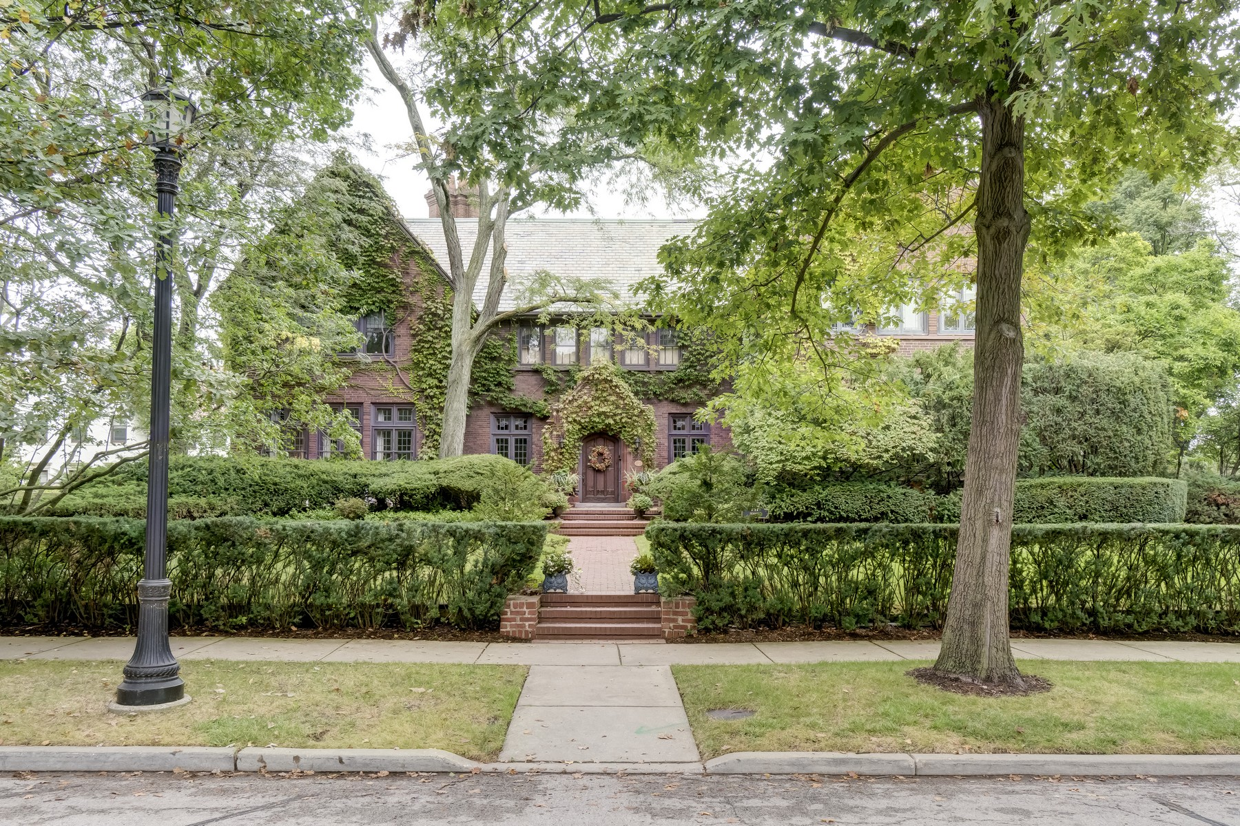 Single Family Homes for Active at Magnificent Tudor mansion and coach house. 147 Dempster Street Evanston, Illinois 60201 United States