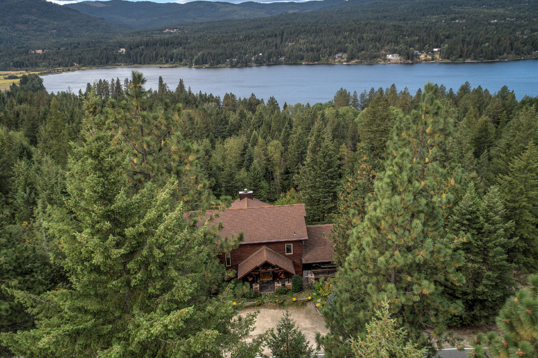 Single Family Homes for Sale at Majestic Mountain and Lake View Home 382 Blacktail Road Cocolalla, Idaho 83813 United States