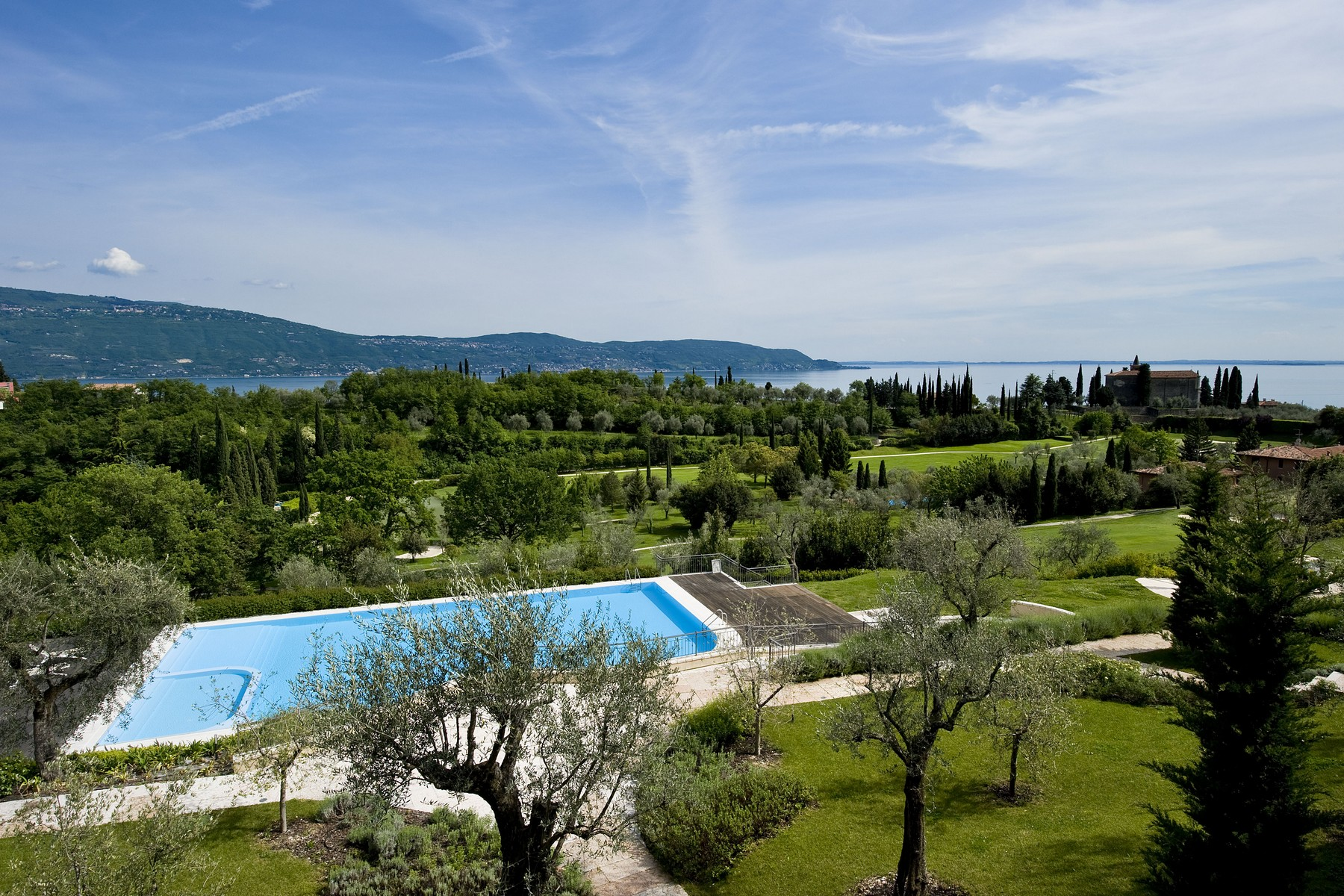 Additional photo for property listing at New apartments inside the Bogliaco Golf Resort Via del Golf Toscolano Maderno, Brescia 25088 Italy