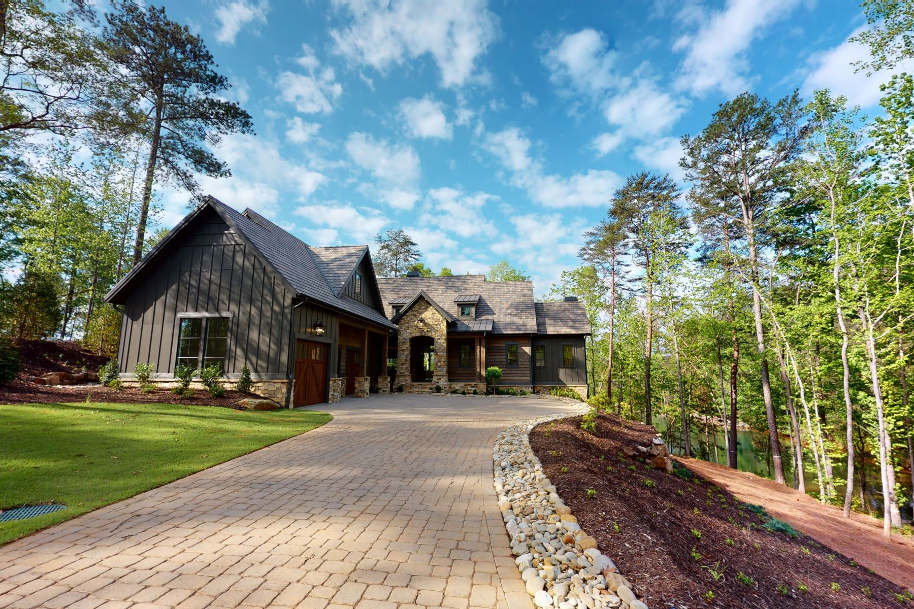 Single Family Homes for Sale at Lakeside Home with Views 415 Peninsula Ridge Sunset, South Carolina 29685 United States