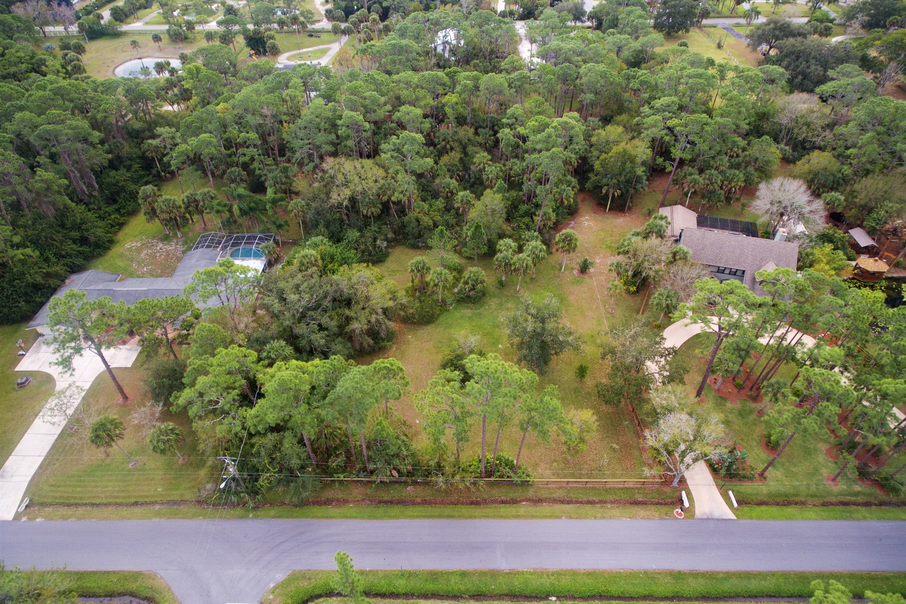 Additional photo for property listing at Beautiful 1.17 acre home site in the heart of the Lake Washington area. TBD Mustang Road Melbourne, Florida 32934 United States
